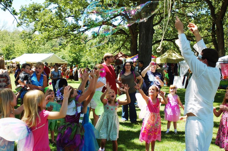 A group of young fairies chase giant bubbles at last year's World of Faeries Festival at Vasa Park in South Elgin.