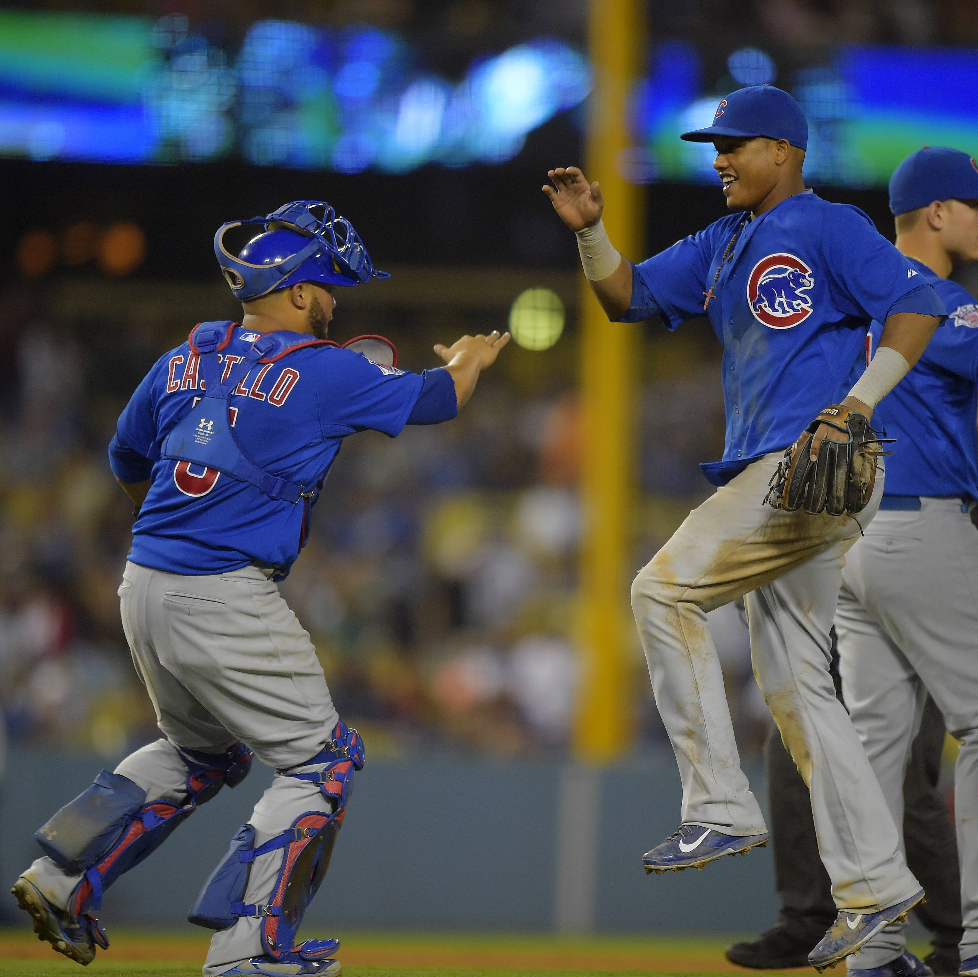 Cubs catcher Welington Castillo, left, and shortstop Starlin Castro celebrate after they defeated the Los Angeles Dodgers 8-2 in a baseball game, Friday, Aug. 1, 2014, in Los Angeles.