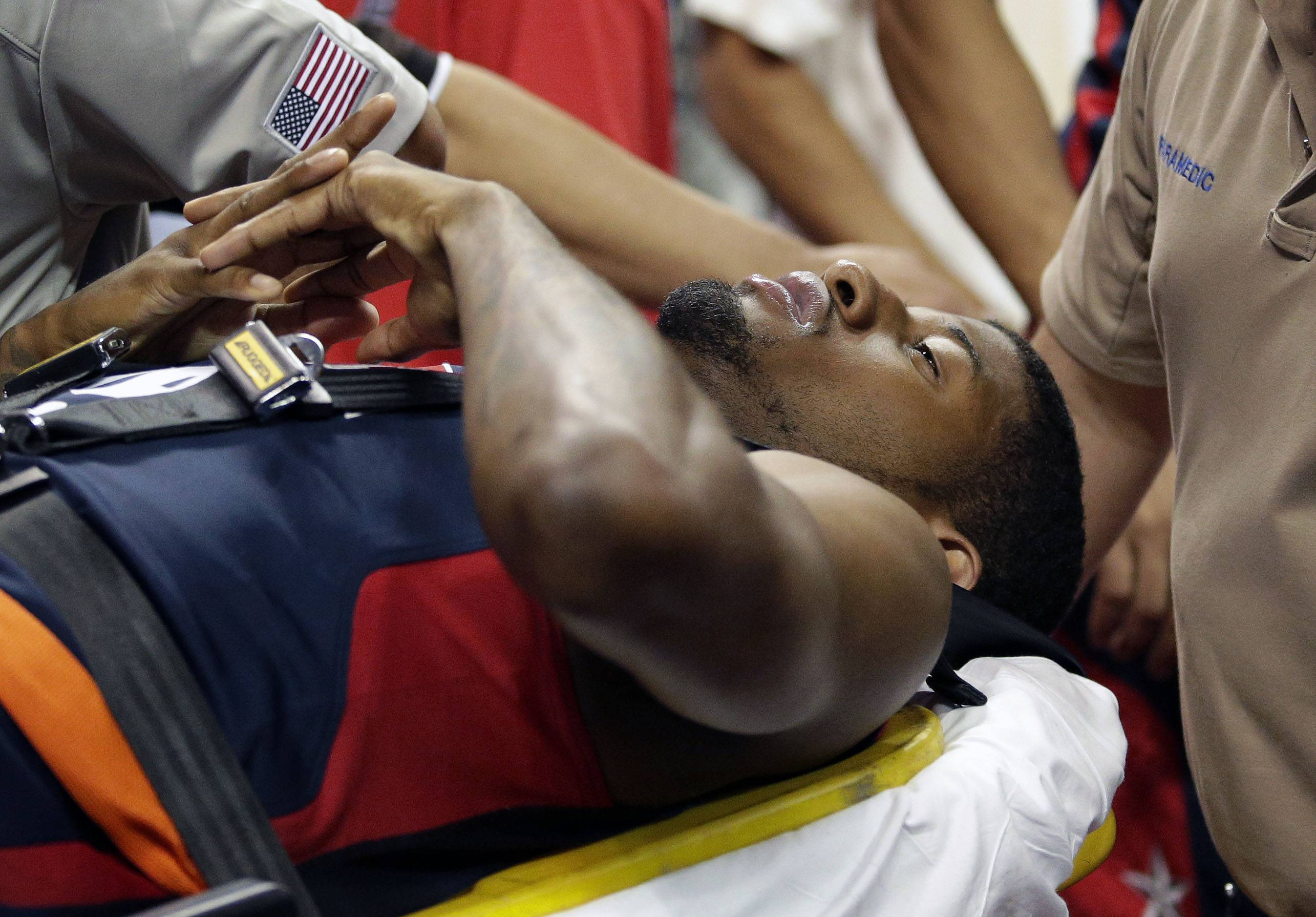 Indiana Pacers' Paul George is taken off the court after he was injured during the USA Basketball Showcase game Friday, Aug. 1, 2014, in Las Vegas.