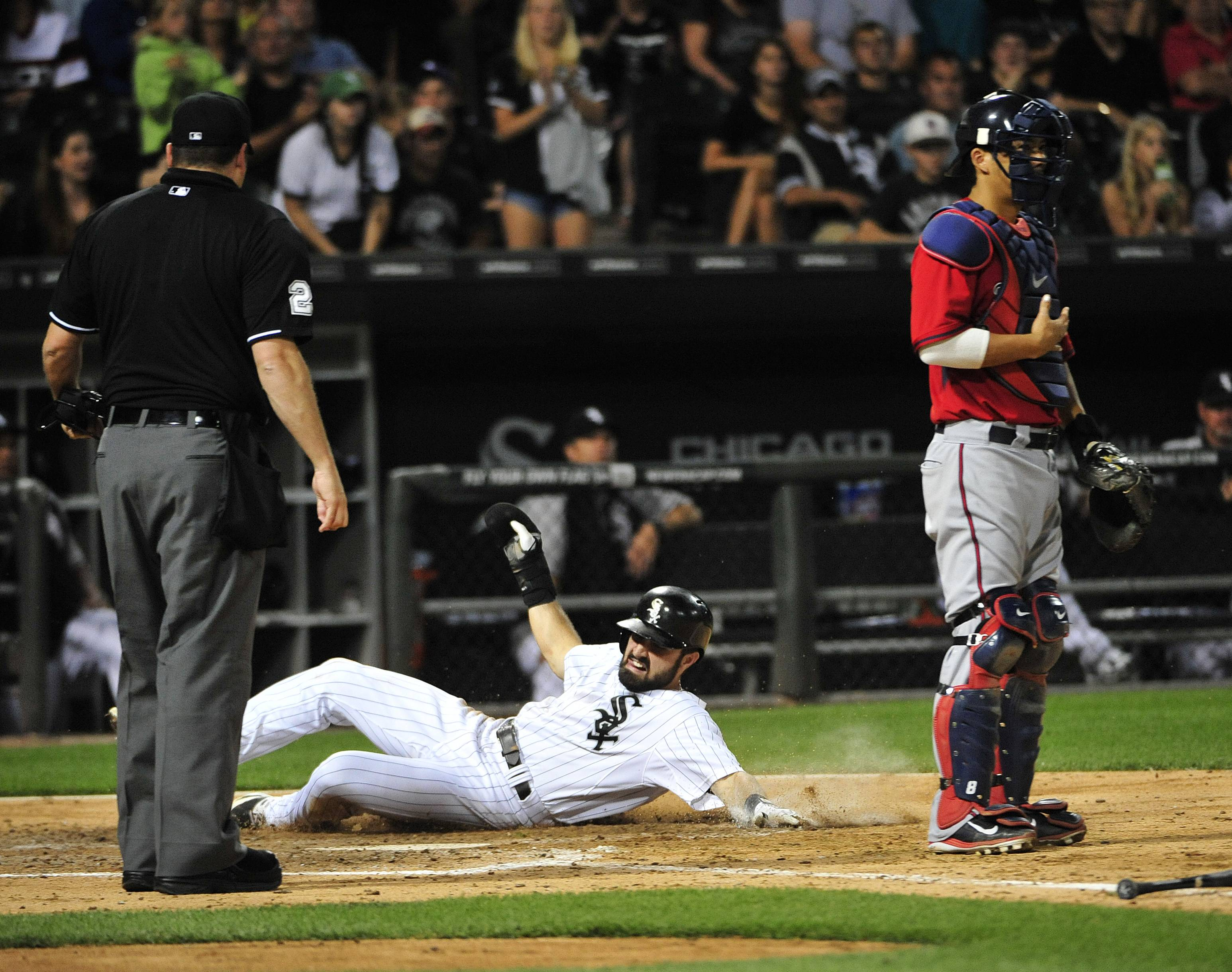 Adam Eaton, center, scores on a single by Jose Abreu as Twins catcher Kurt Suzuki stands nearby during Friday's game at U.S. Cellular Field.