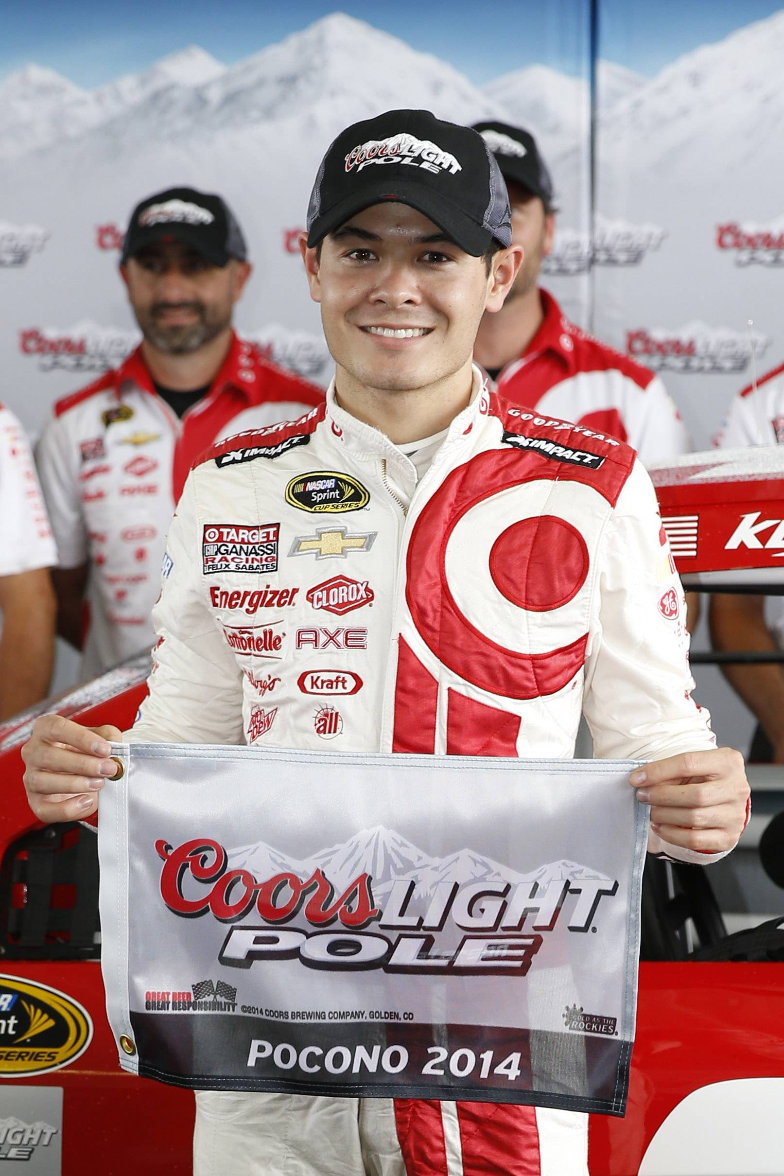 Kyle Larson poses with the pole award after qualifying in first position for Sunday's NASCAR Sprint Cup Series auto race at Pocono Raceway, Friday, Aug. 1, 2014, in Long Pond, Pa.