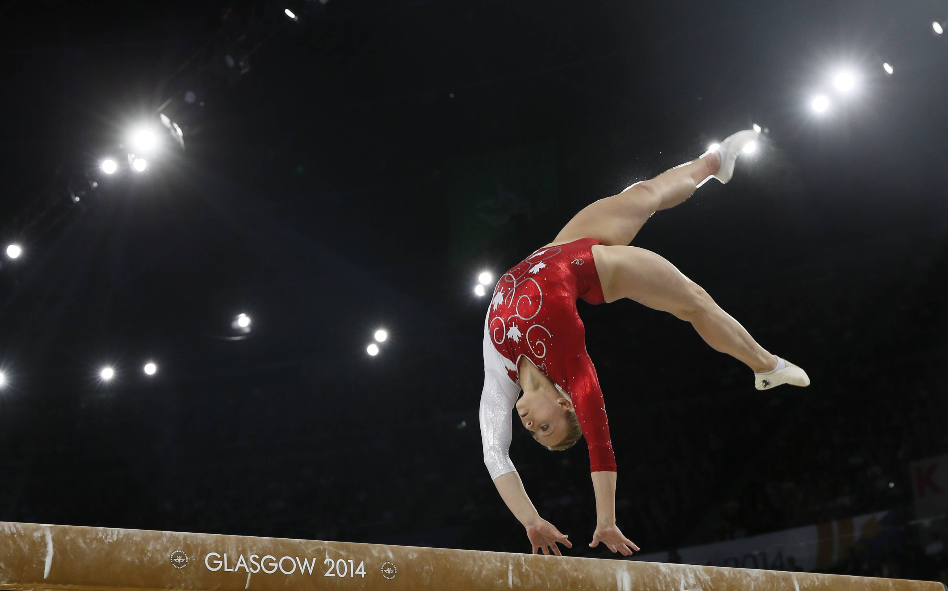 Elsabeth Black of Canada performs her routine during the women's individual beam final at the Commonwealth Games Glasgow 2014, in Glasgow, Scotland, Friday, Aug., 1, 2014. Black won the gold medal.