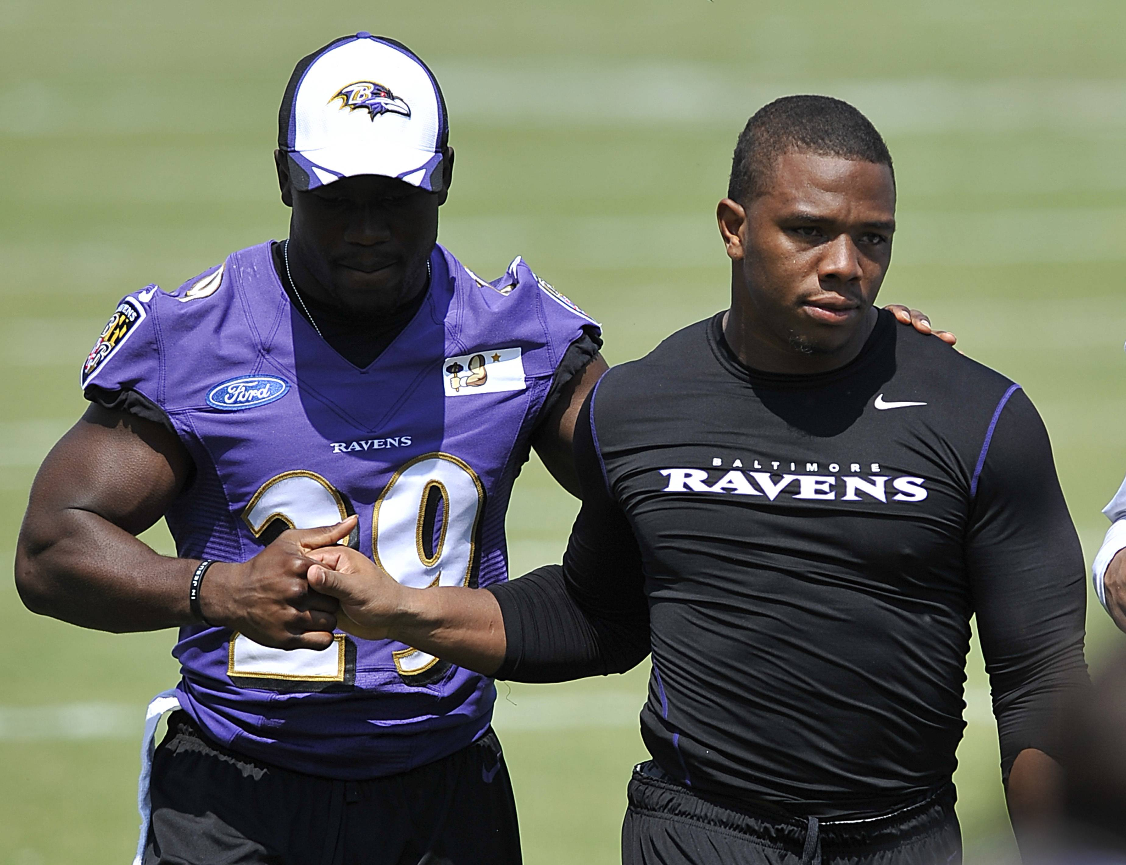 Baltimore Ravens running back Ray Rice, right, walks off the field with Justin Forsett before addressing the media at a news conference after NFL football training camp practice, Thursday, July 31, 2014, in Owings Mills, Md.