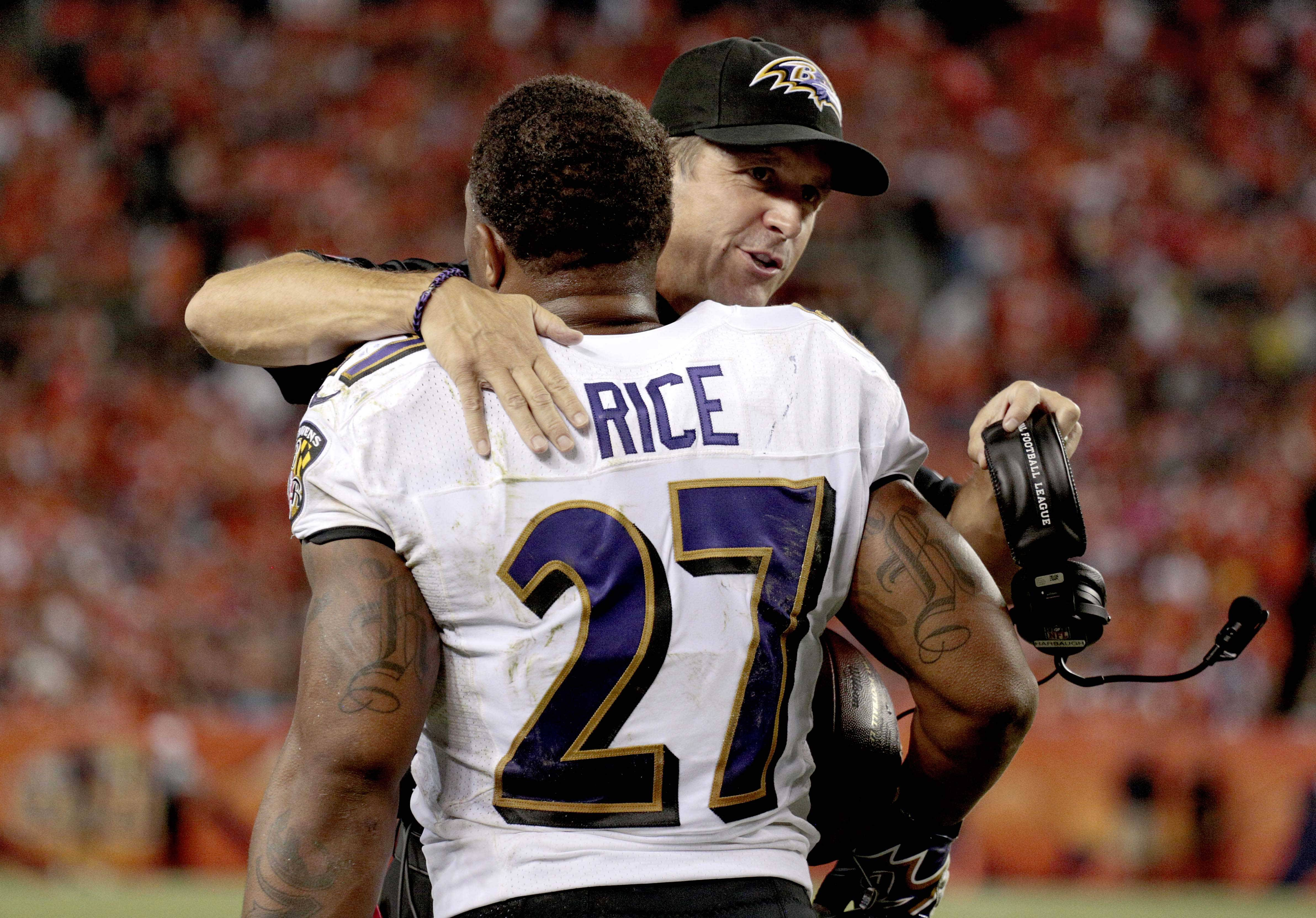 Baltimore Ravens head coach John Harbaugh hugs Ray Rice (27) after Rice scored a touchdown against the Denver Broncos during the first half of an NFL football game, Thursday, Sept. 5, 2013, in Denver.