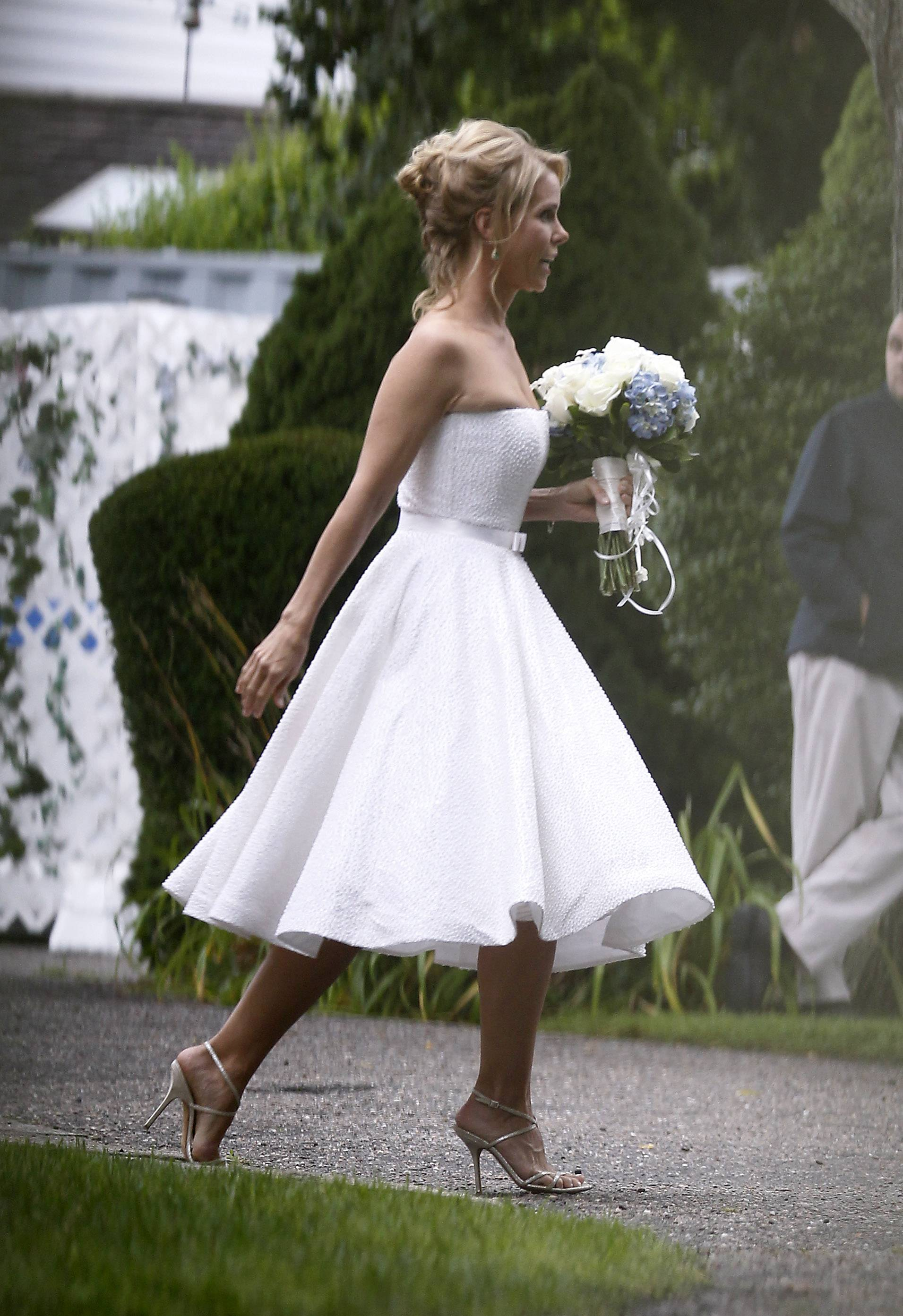 Actress Cheryl Hines walks across a lawn to the tent where her wedding to Robert F. Kennedy Jr., will take place Saturday in Hyannis Port, Mass.