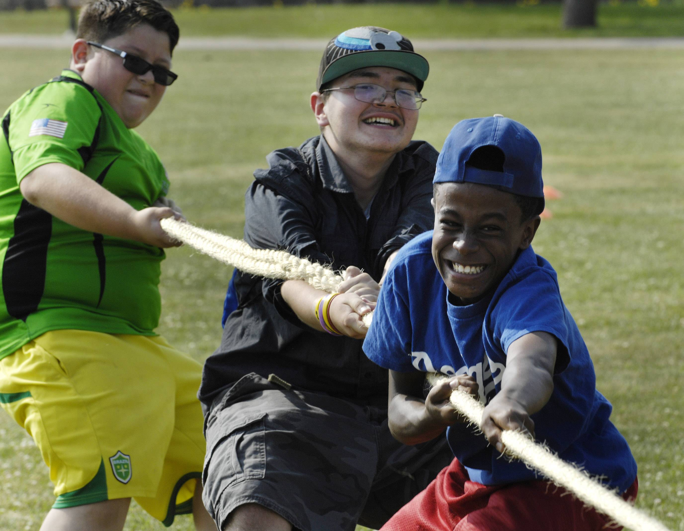 Front to back, Chauncey Broussard, 13, Semin Muminovic, 14, and Joshua Lopez, 12, all of Hoffman Estates participate in a tug-of-war Saturday during the Party in the Park at Highpoint Park in Hoffman Estates.
