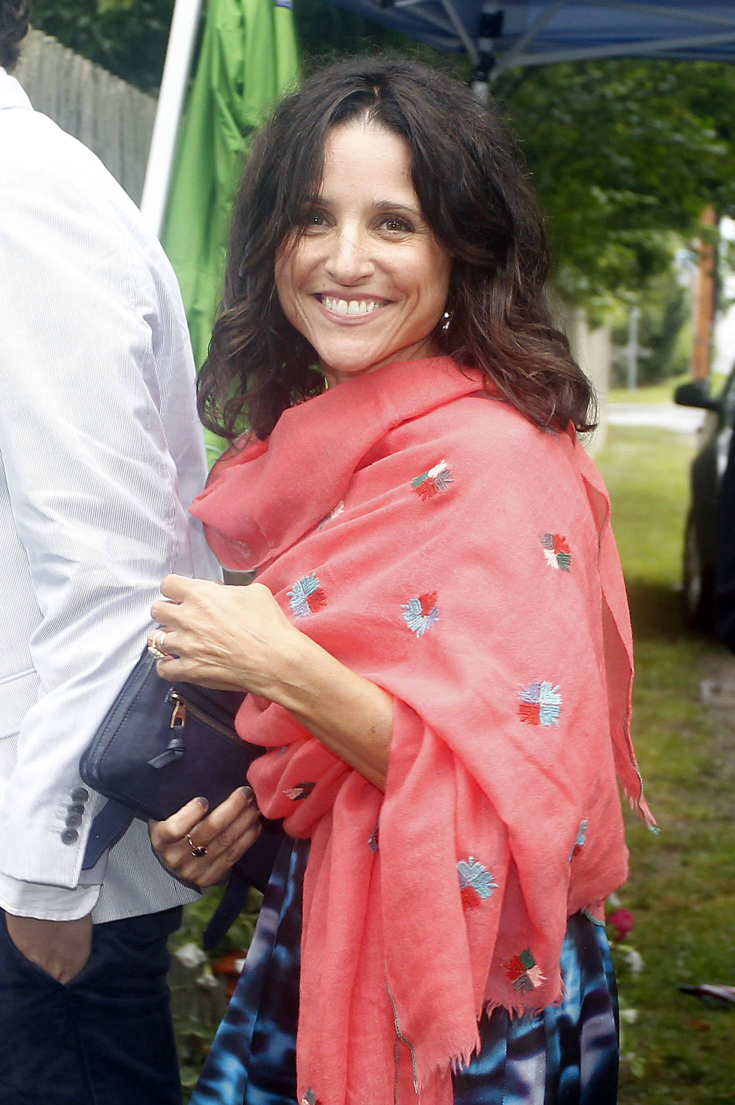 Julia Louis-Dreyfus arrives Saturday at the Kennedy Compound for the wedding of Robert F. Kennedy Jr., and actress Cheryl Hines in Hyannis Port, Mass.