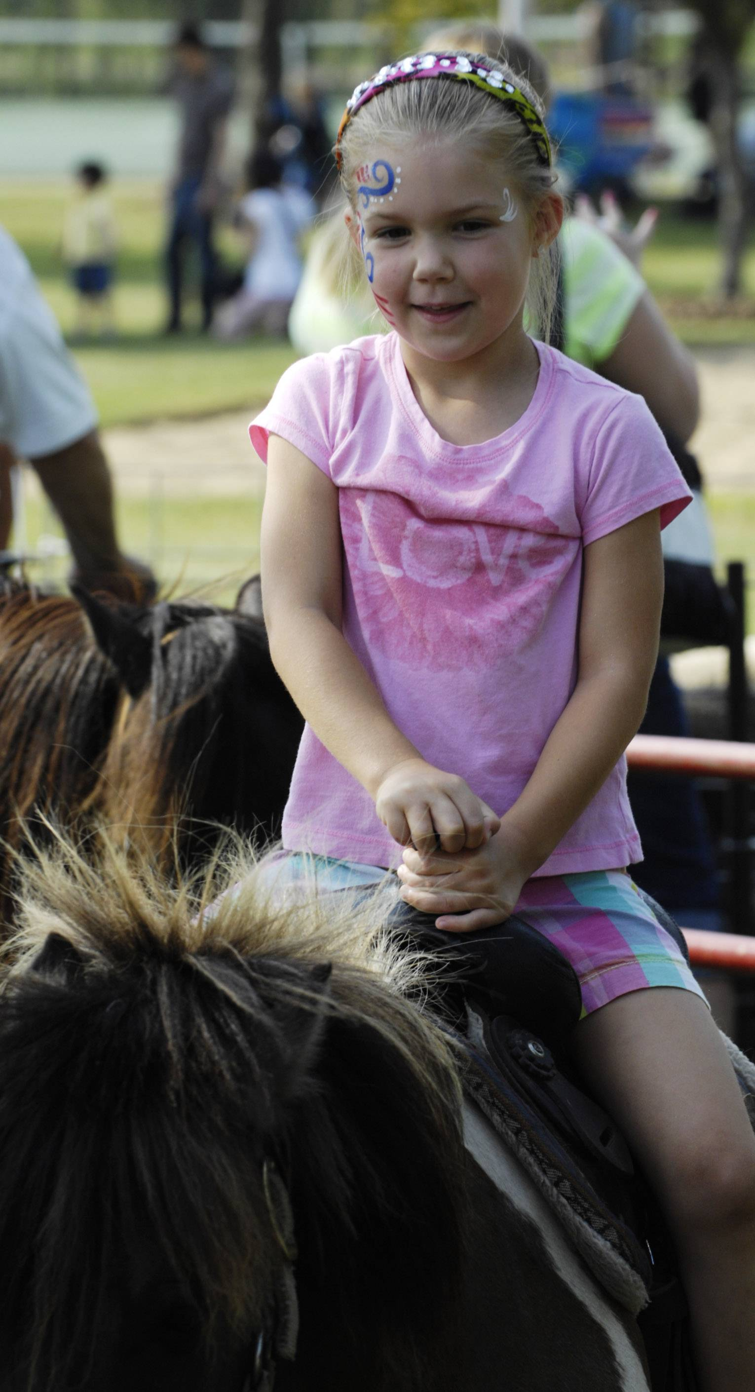 Shelby Walsh, 6, of Gilberts, whose parents live in Hoffman Estates, rides a pony Saturday during the Party in the Park at Highpoint Park in Hoffman Estates.