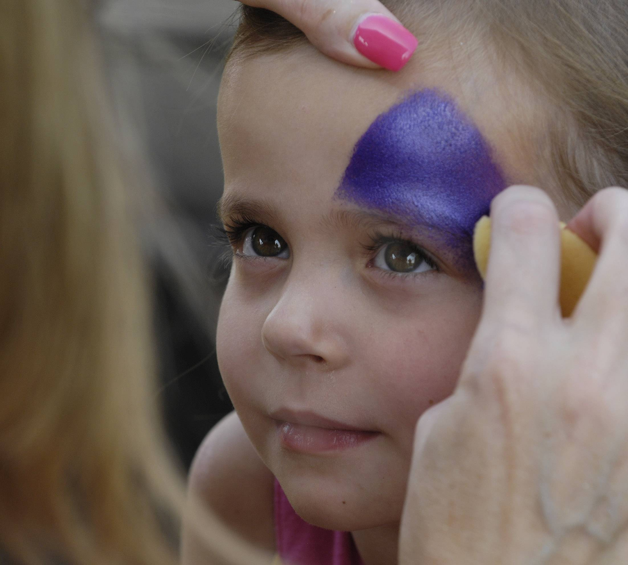 Kiya Chesak, 4, of Algonquin, has her face painted Saturday during the Party in the Park at Highpoint Park in Hoffman Estates. Her mom works for the Hoffman Estates Park District.