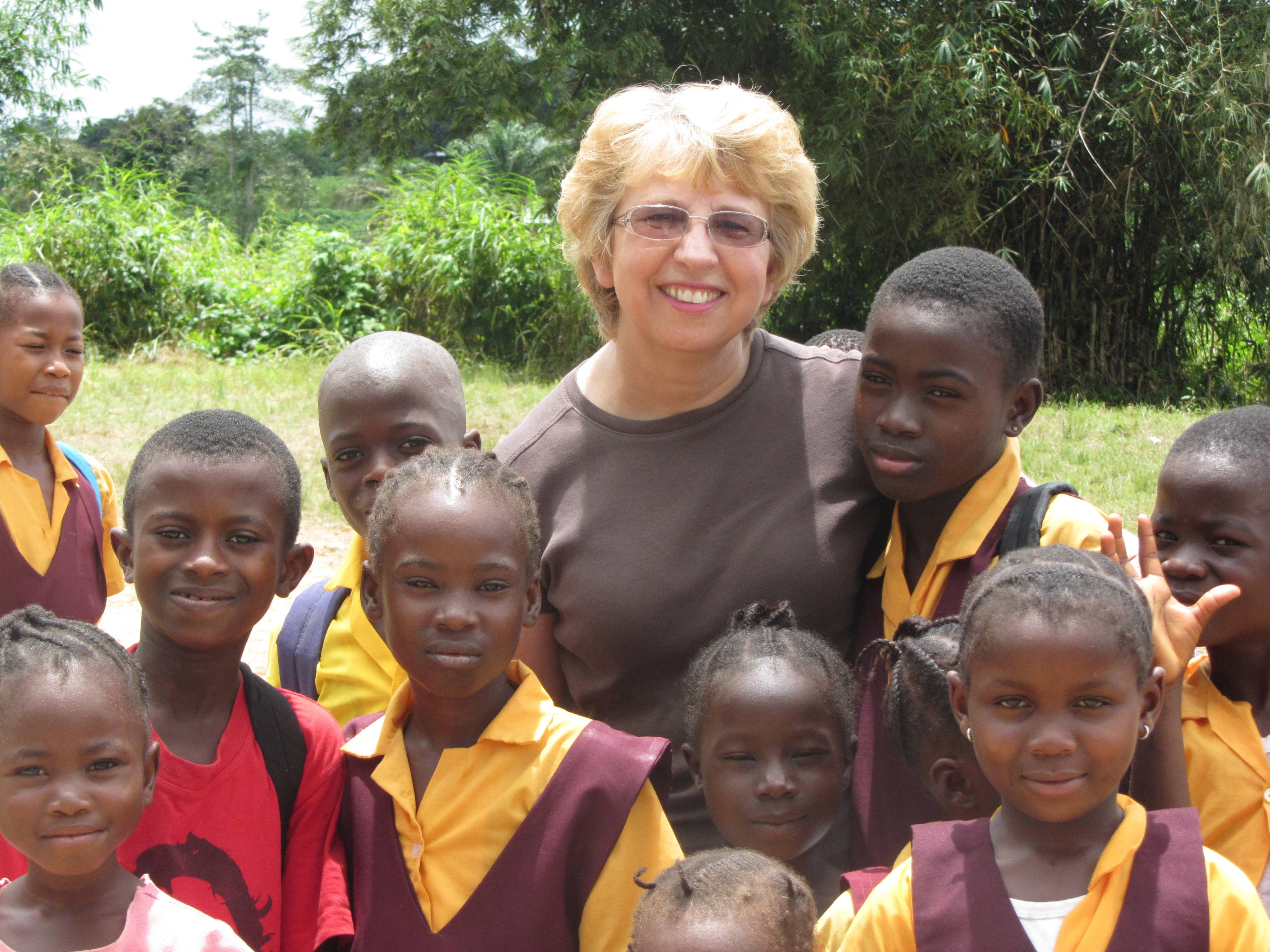 Nancy Writebol, with children in Liberia. Writebol is one of two Americans working for a missionary group in Liberia diagnosed with Ebola. Plans are underway to bring her back for treatment.