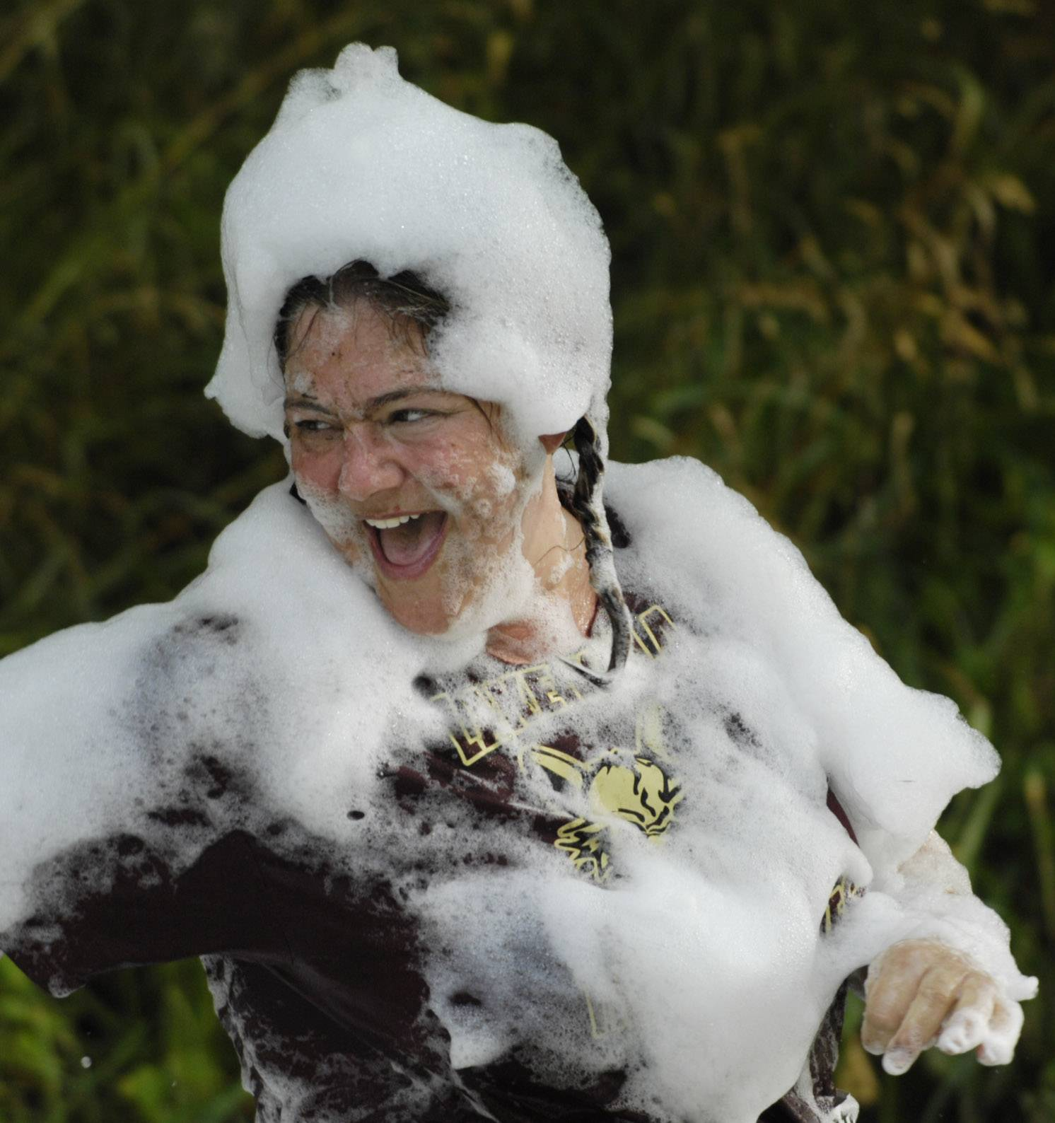 Lisa Kozanecki of Lake Villa laughs as she finishes Saturday's Mud Run at Caboose Park in Lake Villa.