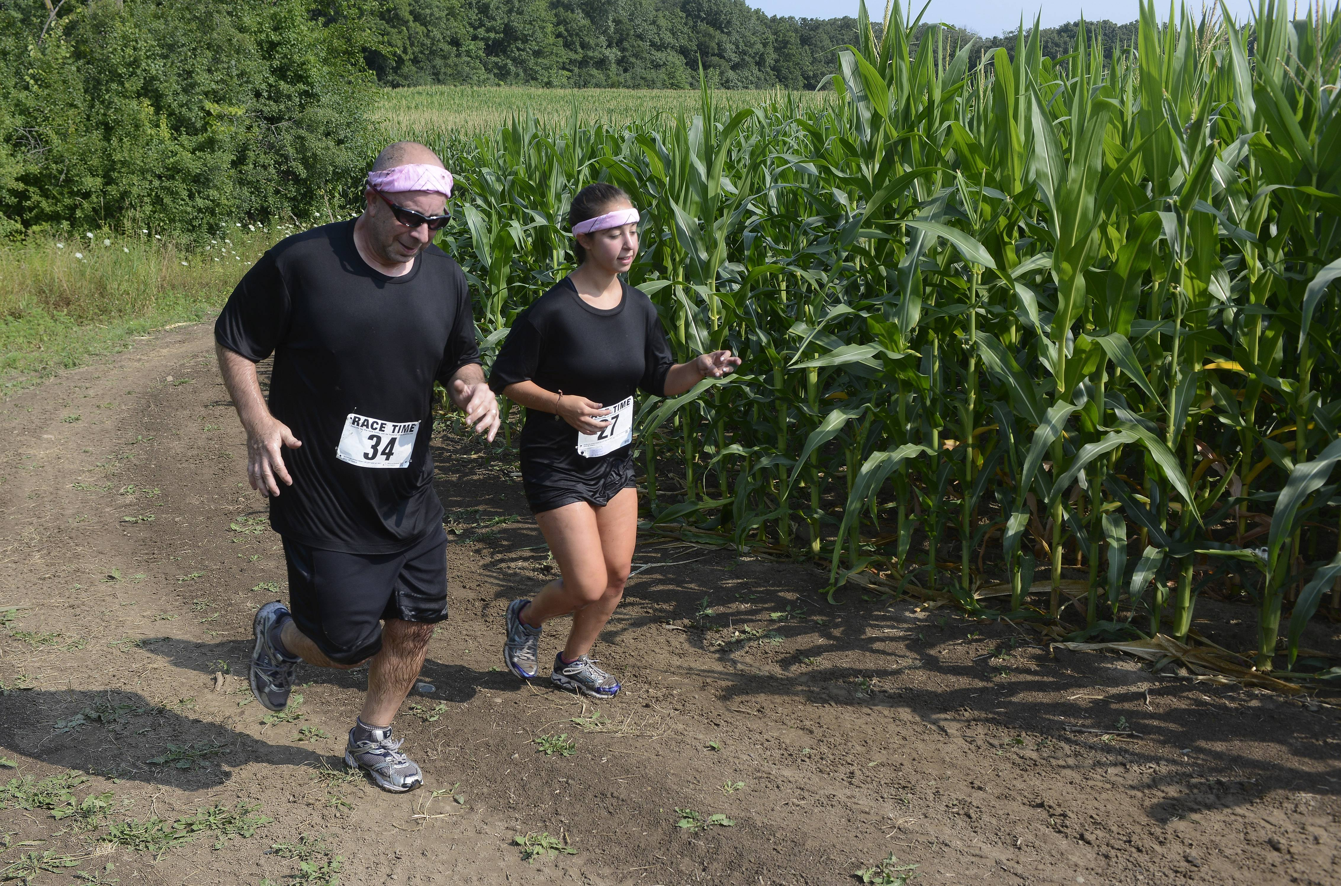 Larry Appelbaum of Vernon Hills and his daughter, Carlee, compete in Saturday's Mud Run at Caboose Park in Lake Villa.