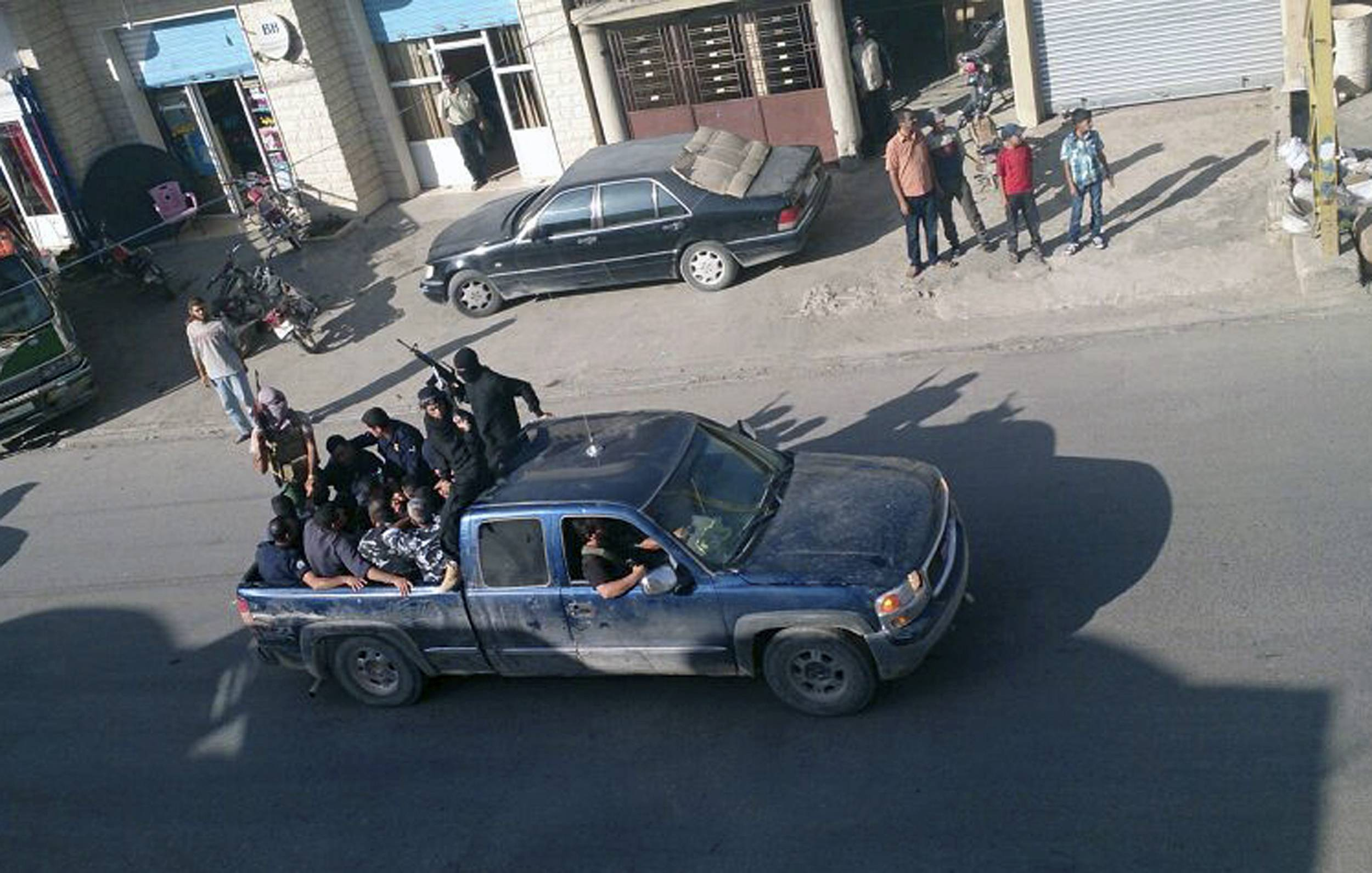 Gunmen drive away Saturday with about a dozen men, two in camouflage police uniforms, in Arsal, a Sunni Muslim town near the Syrian border in eastern Lebanon.