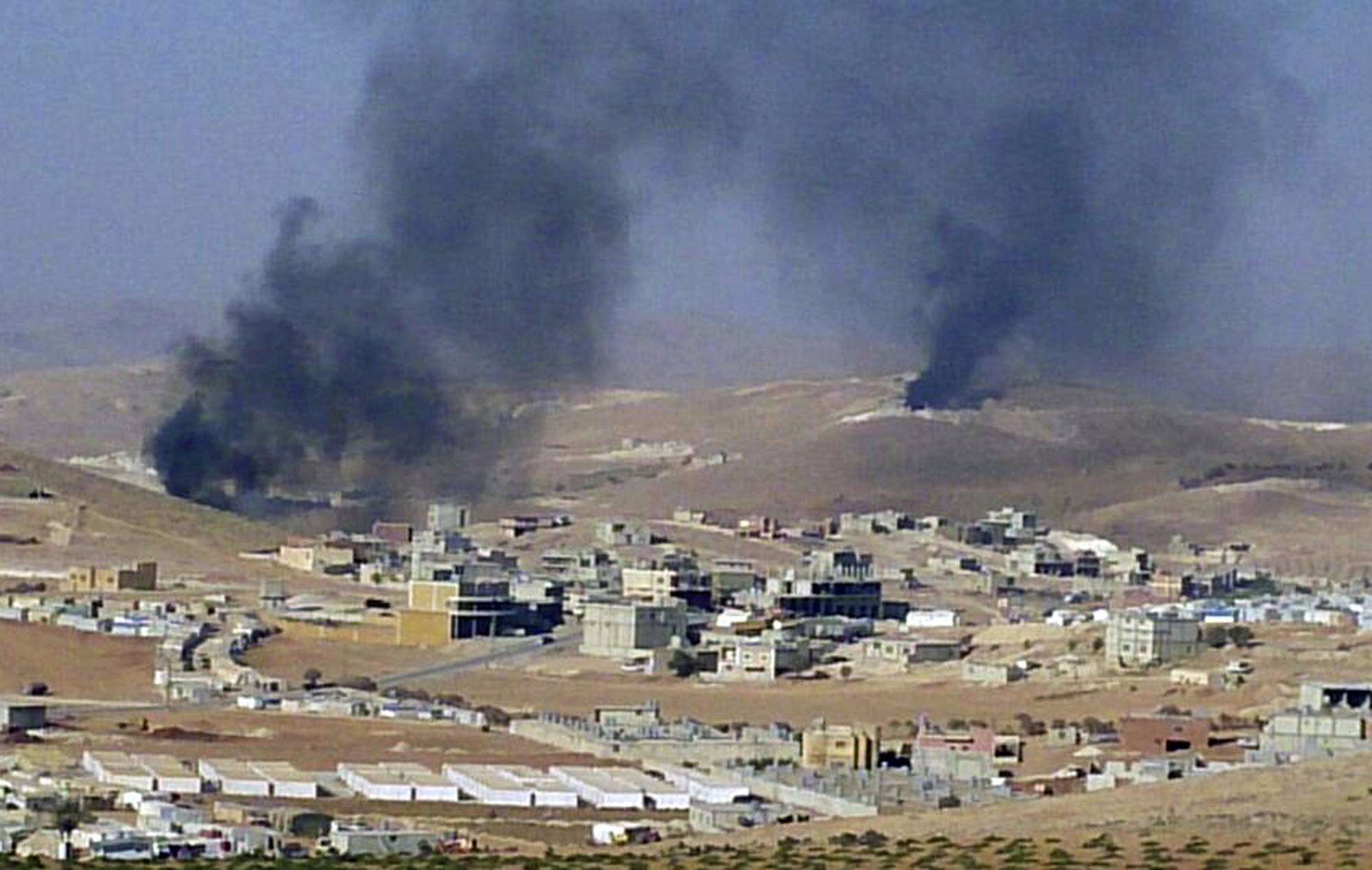 Smoke billows Saturday from the Lebanese town of Arsal, a Sunni Muslim town near the Syrian border in eastern Lebanon.