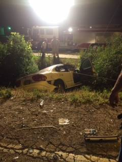 Round Lake Park police said a driver is in critical condition after he drove around crossing gates and in front of a Metra commuter train early Saturday.