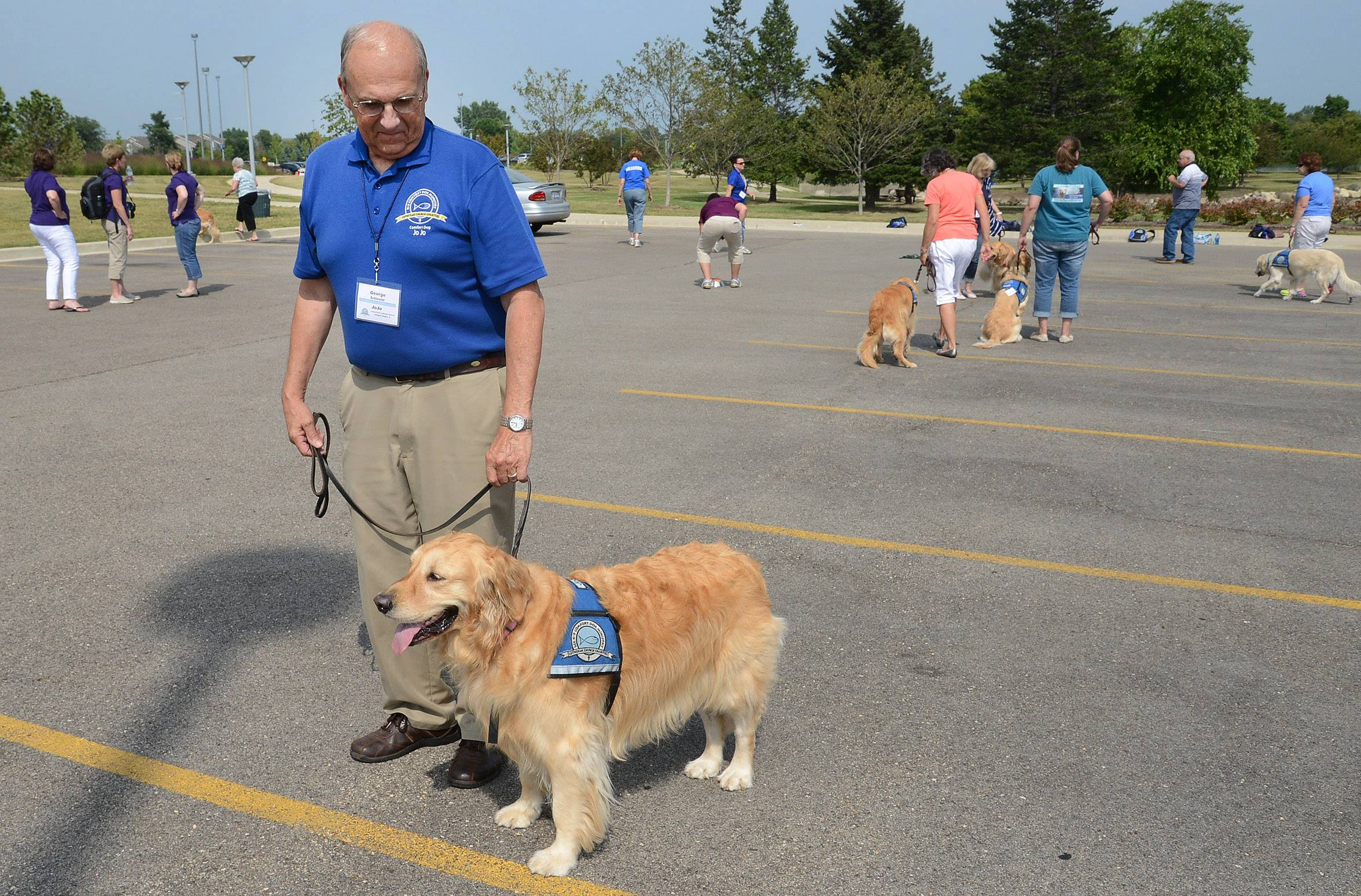 George Schiestel of Arlington Heights works with his dog JoJo during a dog obedience session as part of Lutheran Church Charities Comfort Dog Ministry national convention Friday at Harper College.