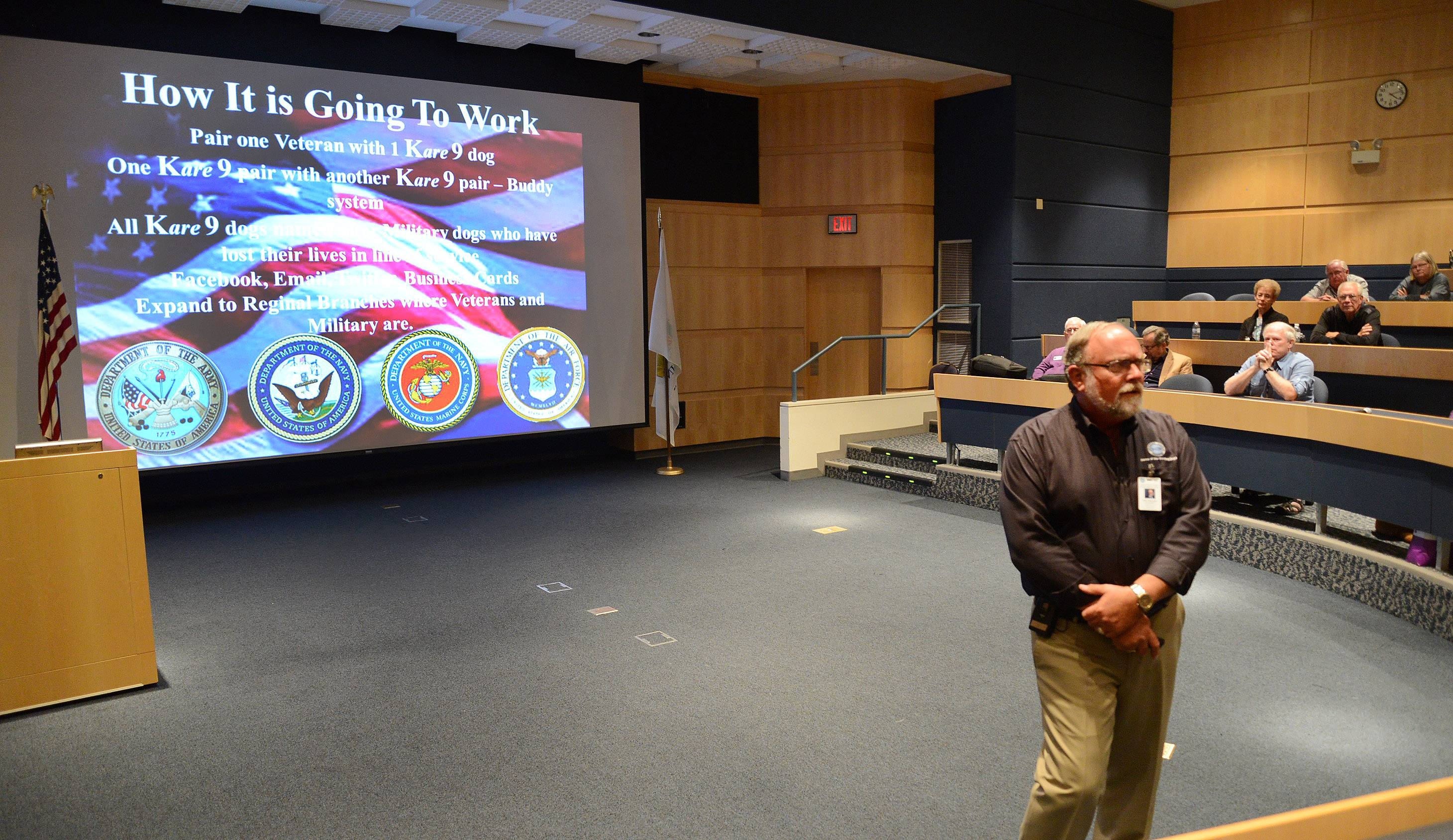 Tim Hetzner, president of Lutheran Church Charities, who runs the Comfort Dog Ministry, launches the Kare-9 Ministry geared specifically to military veterans and their families Friday during the group's national convention at Harper College.
