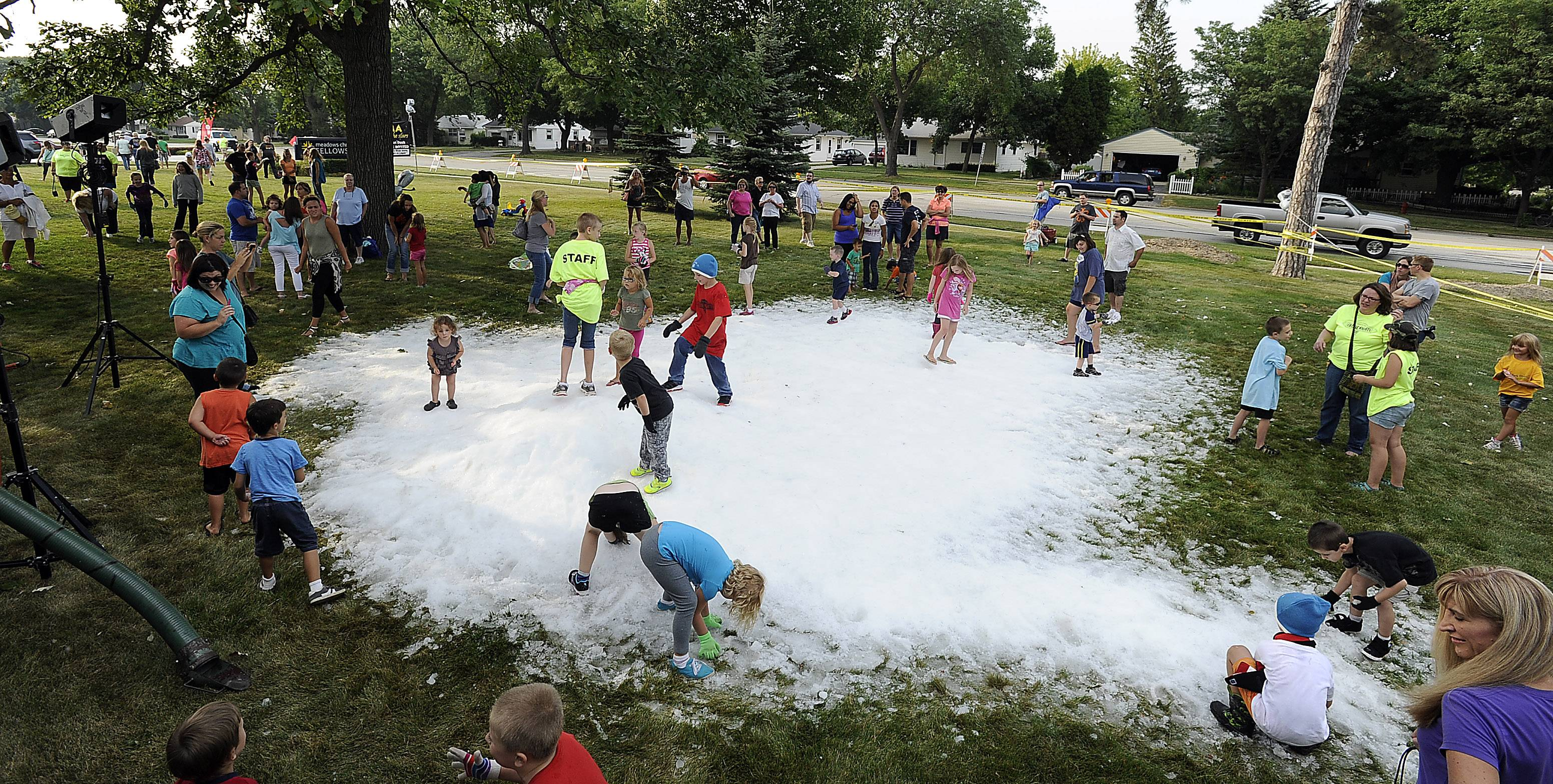 "Kids play in the snow Friday night before the showing of the movie ""Frozen"" in Rolling Meadows."