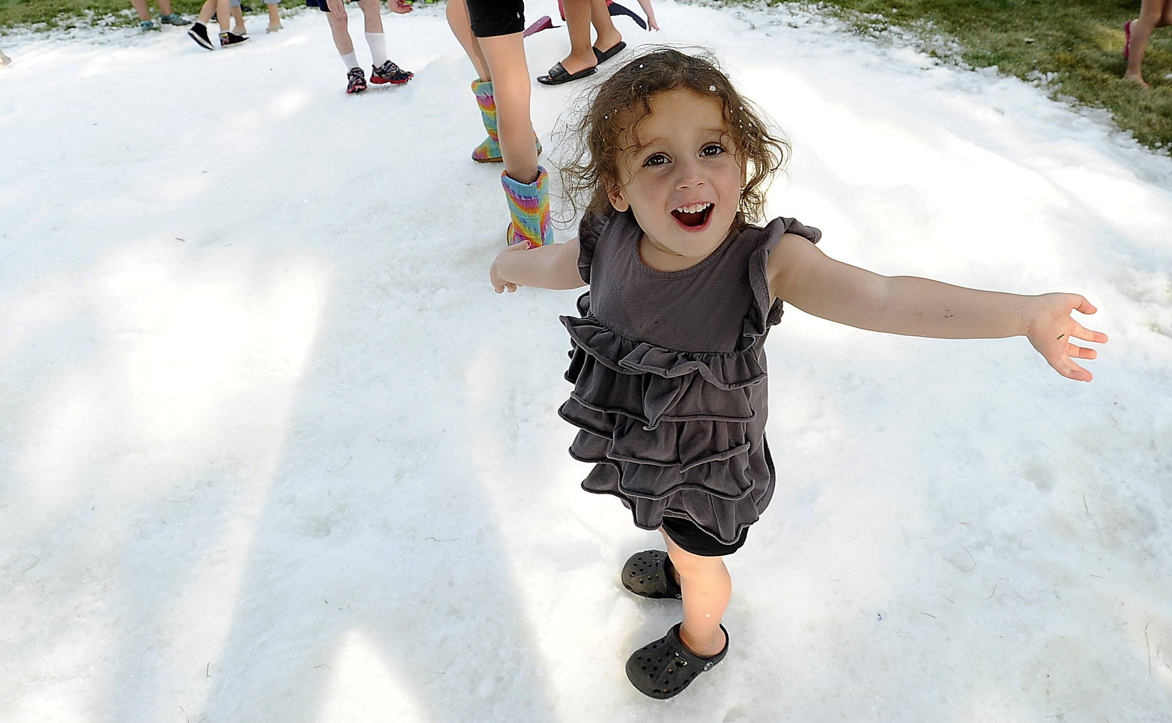 Alaina Rugliancich, 2, of Rolling Meadows was in amazement as she discovered snow on a hot August night in Rolling Meadows.