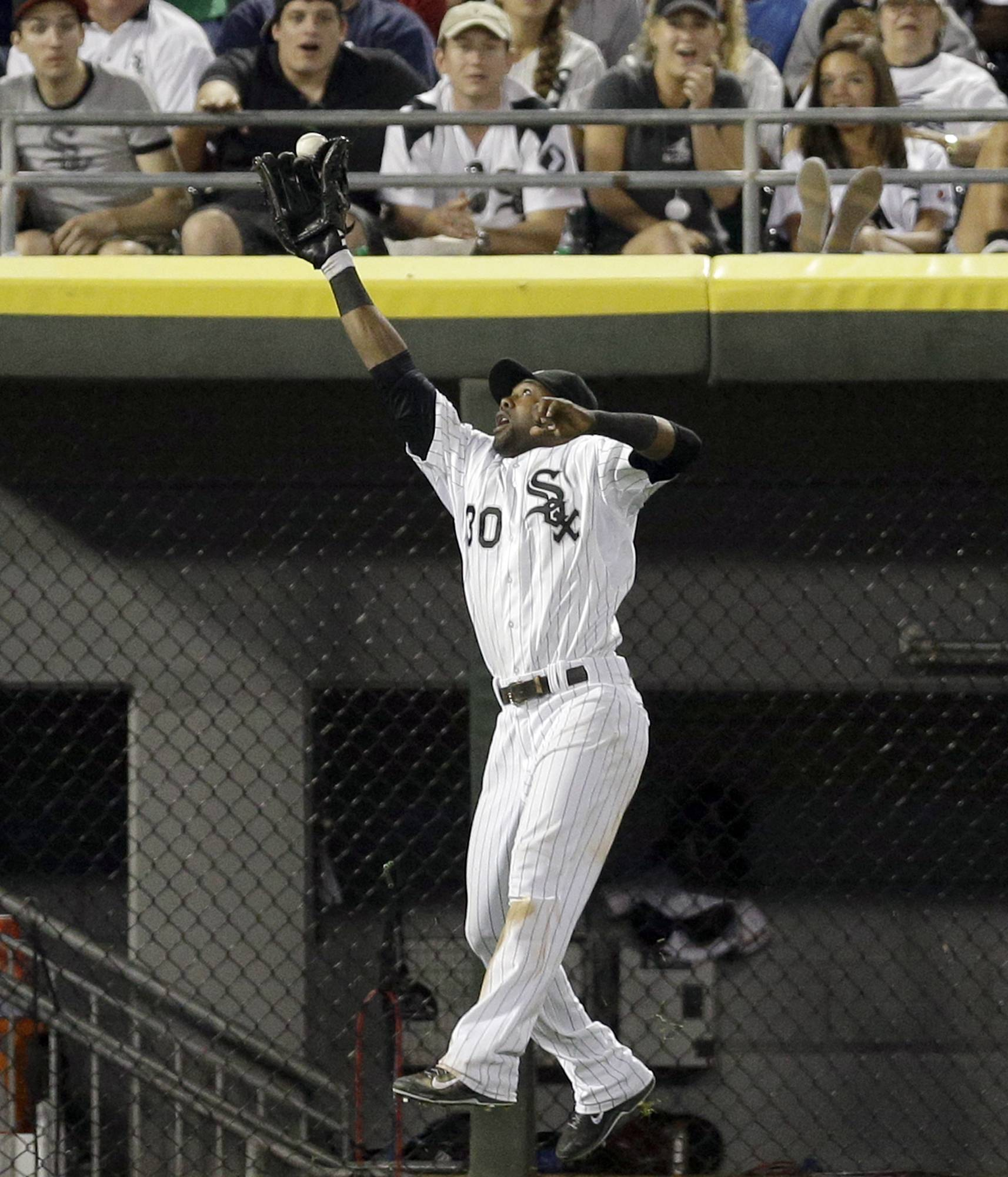 Chicago White Sox left fielder Alejandro De Aza can't make the play on a double hit by Minnesota Twins' Oswaldo Arcia during the eighth inning of a game Saturday in Chicago.