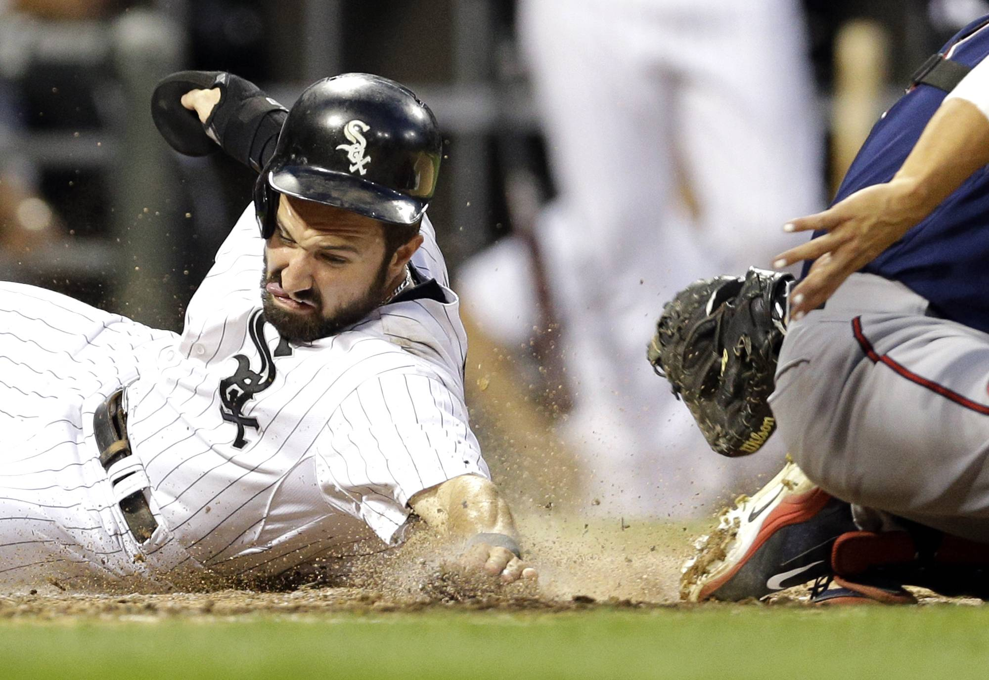 Chicago White Sox's Adam Eaton, left, scores on a double hit by Gordon Beckham as Minnesota Twins catcher Kurt Suzuki applies a late tag during Saturday's game at U.S. Cellular Field. The Sox lost 8-6.