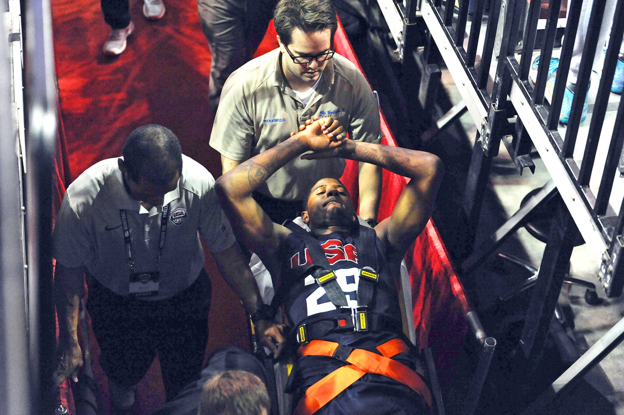 In this photo provided by the Las Vegas News Bureau,  Indiana Pacers' Paul George is carted off the court after breaking his right leg during the USA Basketball Showcase intrasquad game in Las Vegas on Friday, Aug. 1, 2014.