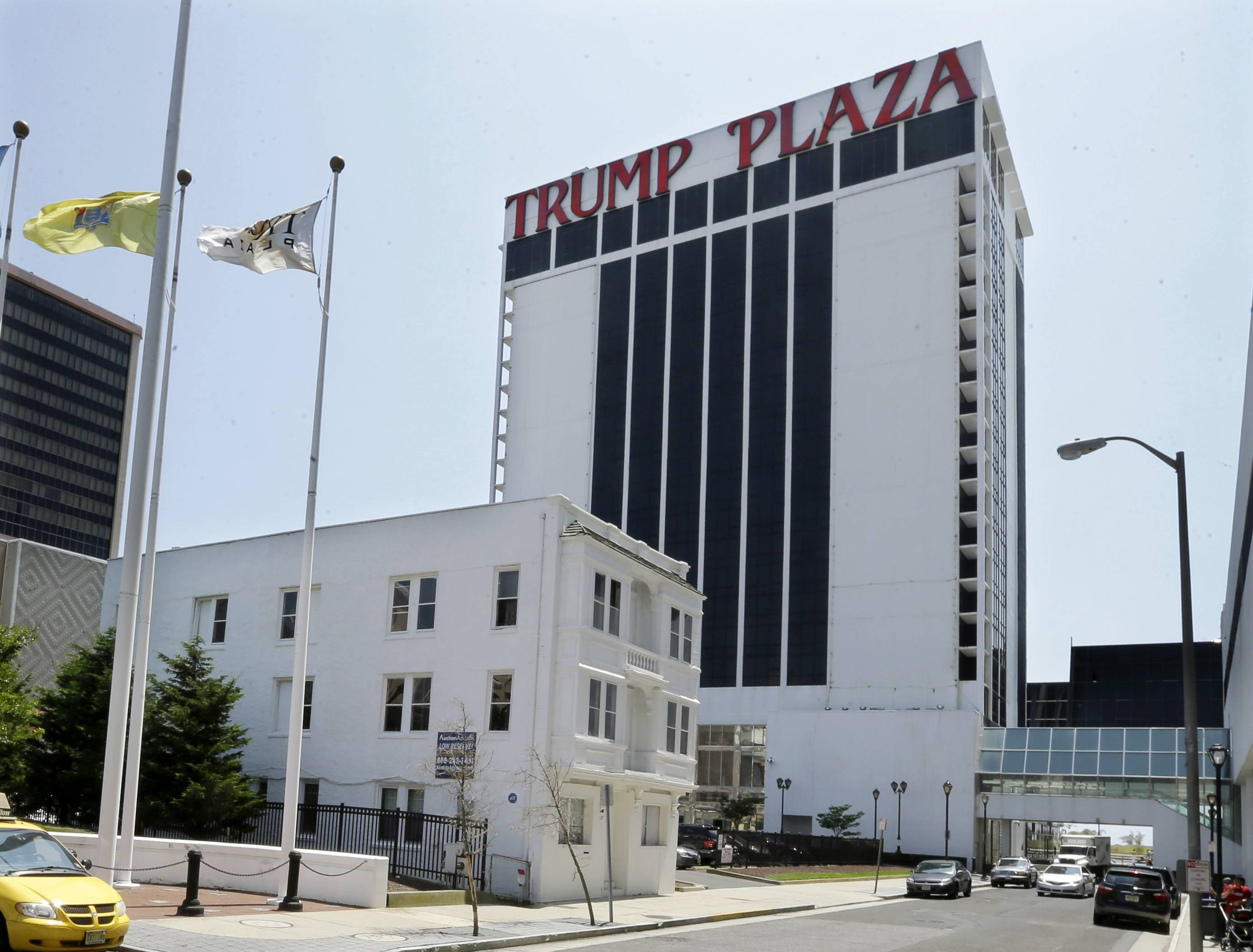 Trump Plaza Hotel and Casino towers over Vera Coking's three story rooming house in Atlantic City, N.J.