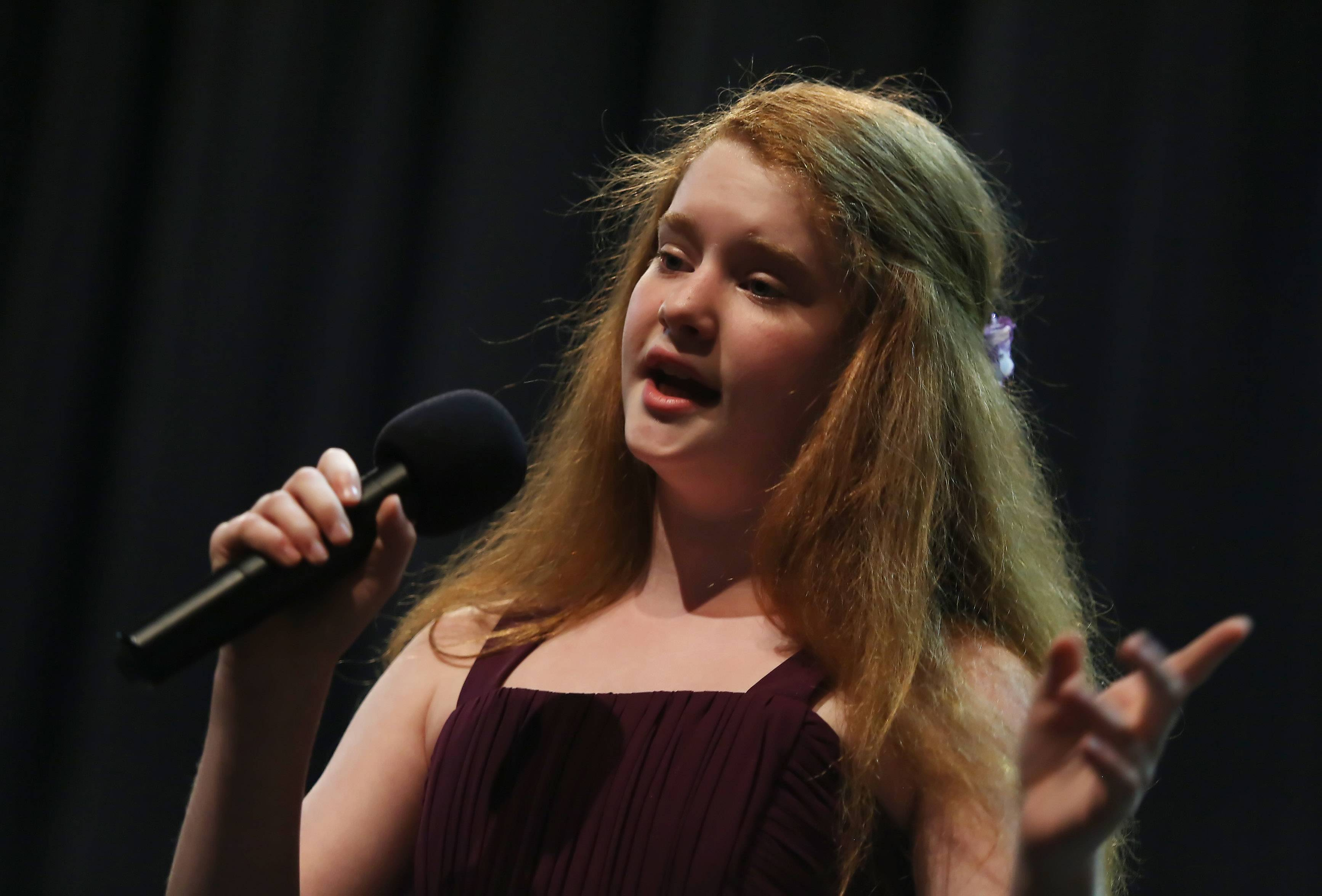 Carly Meyer, 12, performs an operatic piece Sunday at the talent show in Schaumburg.