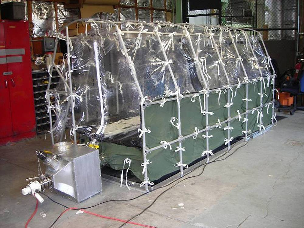 In this undated photo released by the Center for Disease Control, a Aeromedical Biological Containment System which looks like a sealed isolation tent for Ebola air transportation is shown.