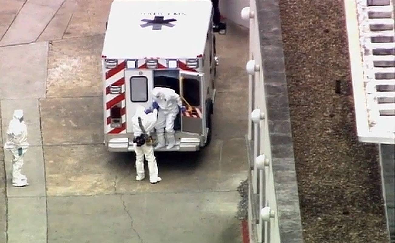 An ambulance arrives Saturday with Ebola victim Dr. Kent Brantly, right, to Emory University Hospital in Atlanta. Brantly, infected with the Ebola virus in Africa, arrived in Atlanta for treatment Saturday, landing in a specially equipped plane at a military base, then being whisked away to one of the most sophisticated hospital isolation units in the country, officials say.