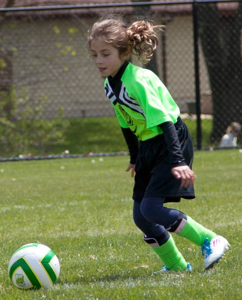 Audrey Nilsen, a member of the Mount Prospect-based Green White soccer club, gets ready to kick the ball during a recent game. The club, which features teams for girls, boys and men, dates back to the mid-1950s.