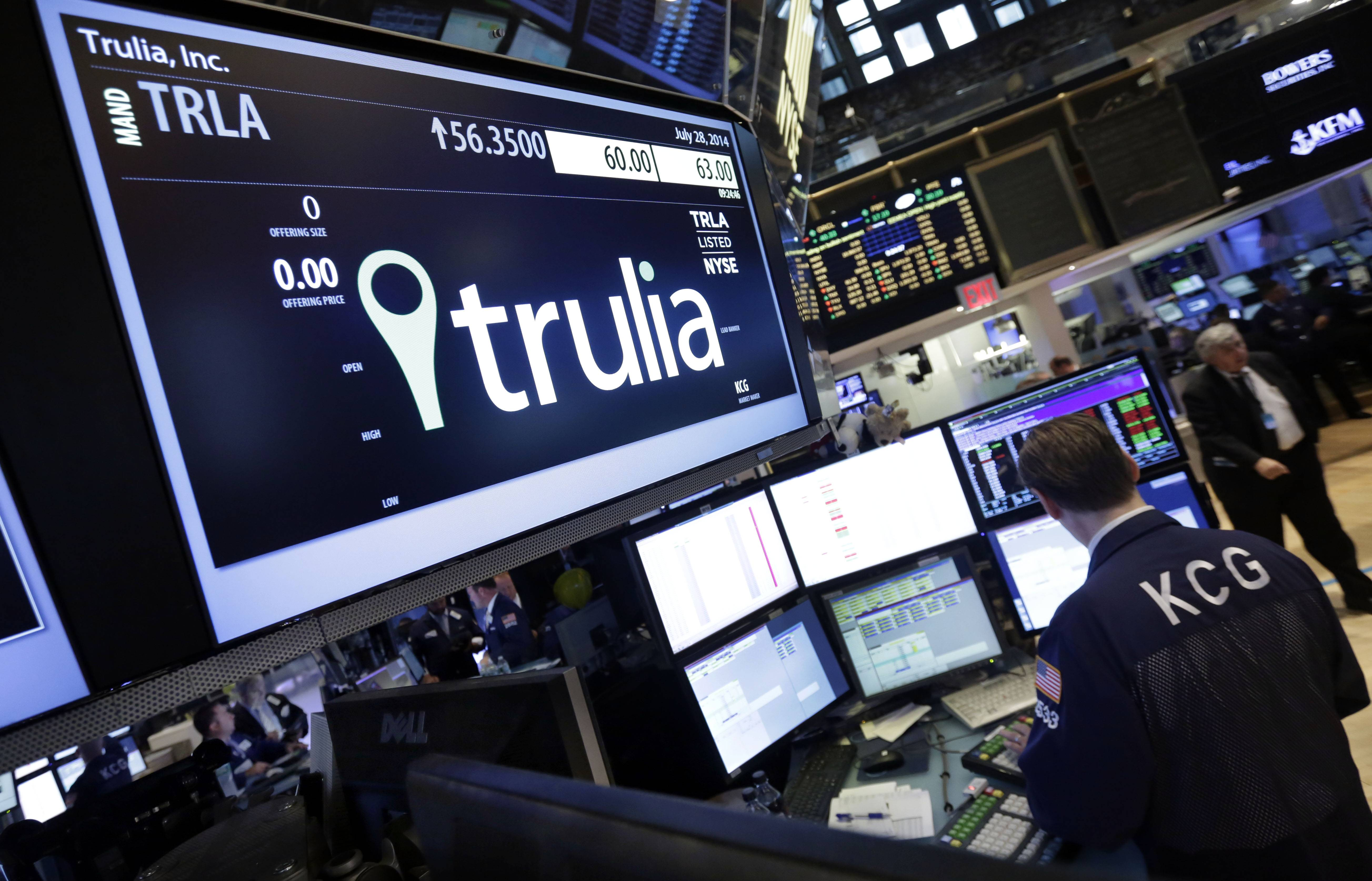 A specialist woks at the post that handles Trulia on the floor of the New York Stock Exchange.
