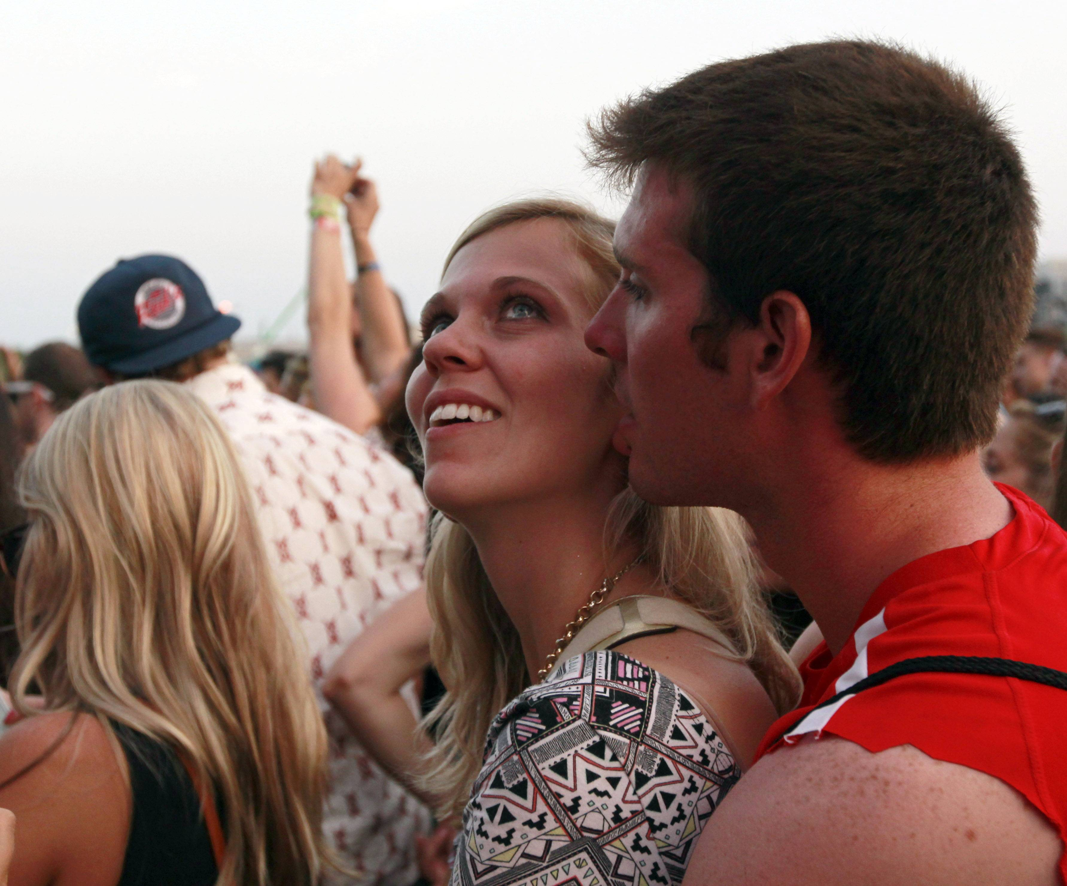 A couple listen to the Head and the Heart during the second day of Lollapalooza on Saturday in Chicago.