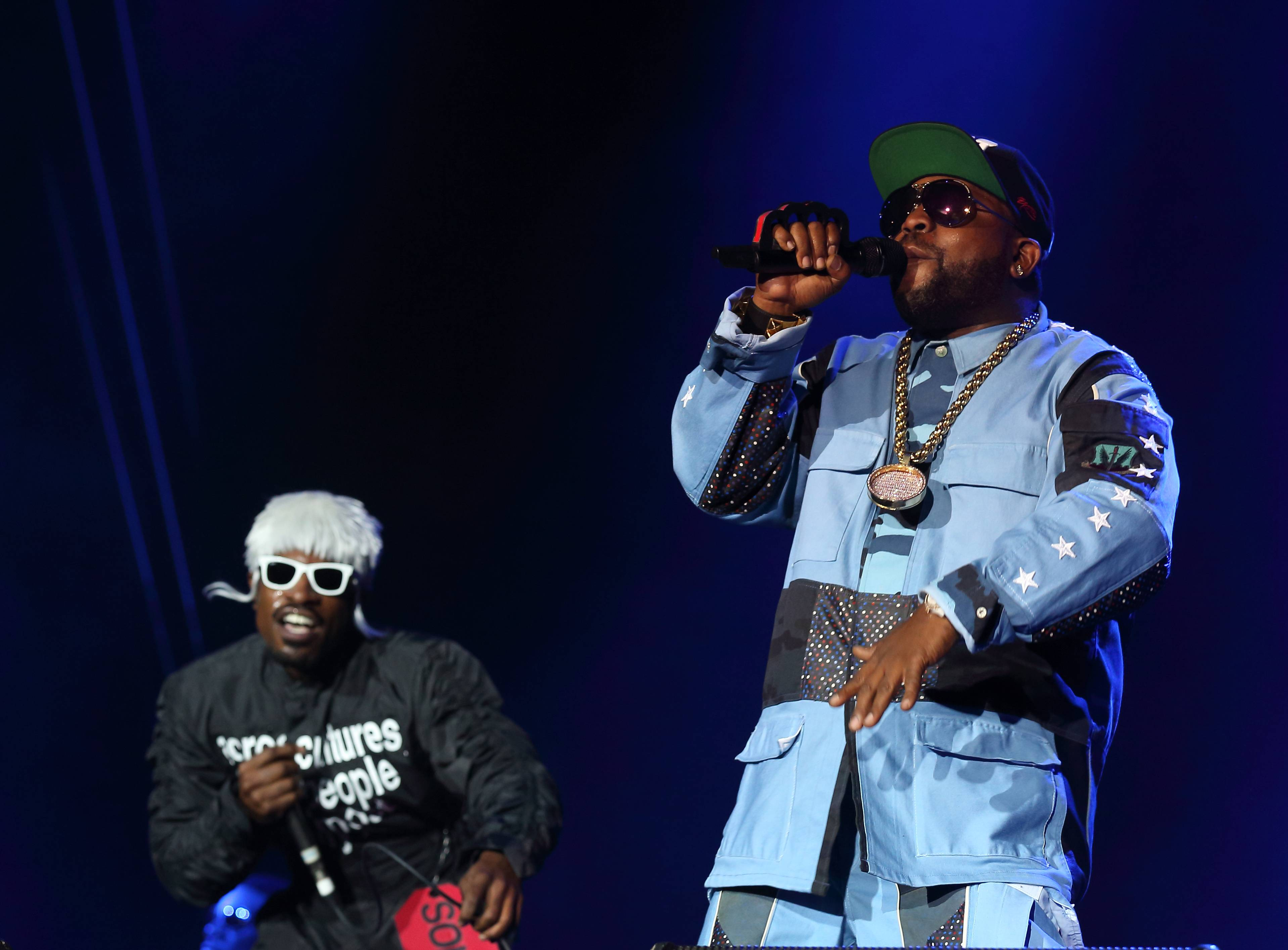 Andre 3000, left, and Big Boi, right, of Outkast close out the second day of Lollapalooza in Chicago's Grant Park.