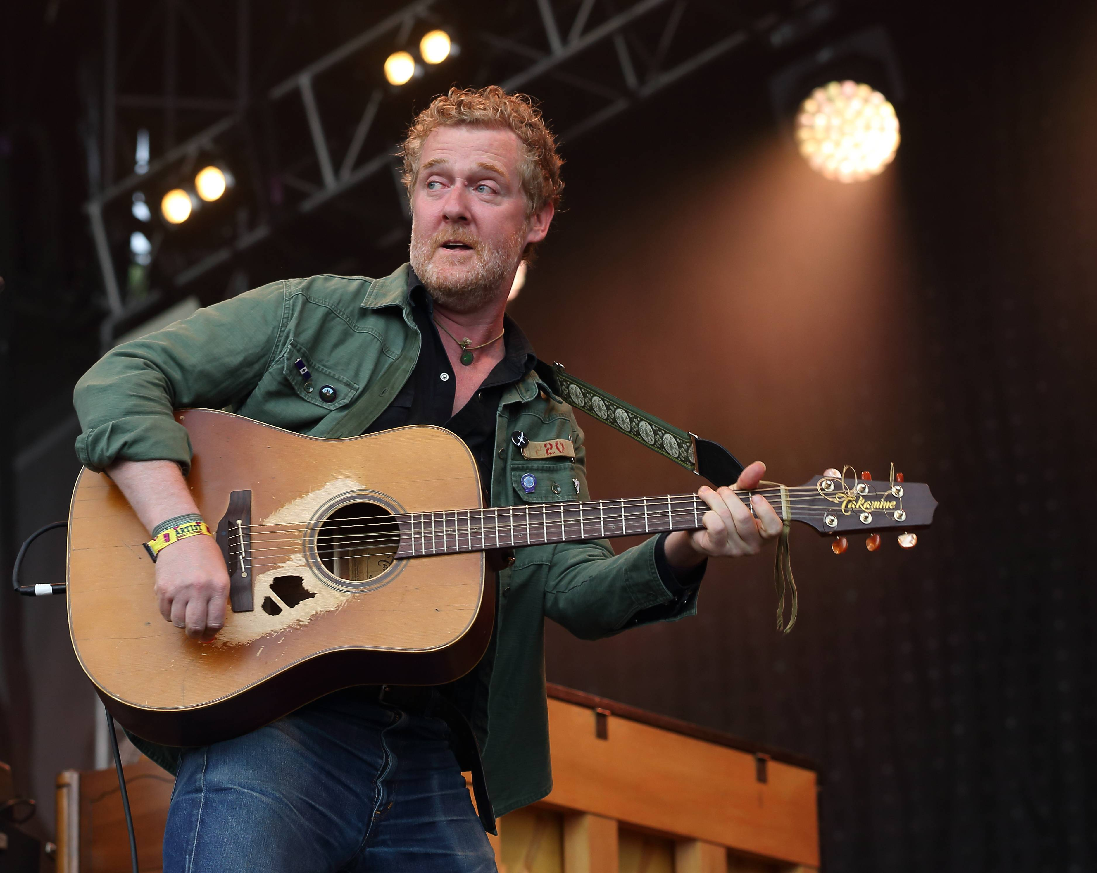 Glen Hansard performs Sunday at Lollapalooza in Chicago's Grant Park.