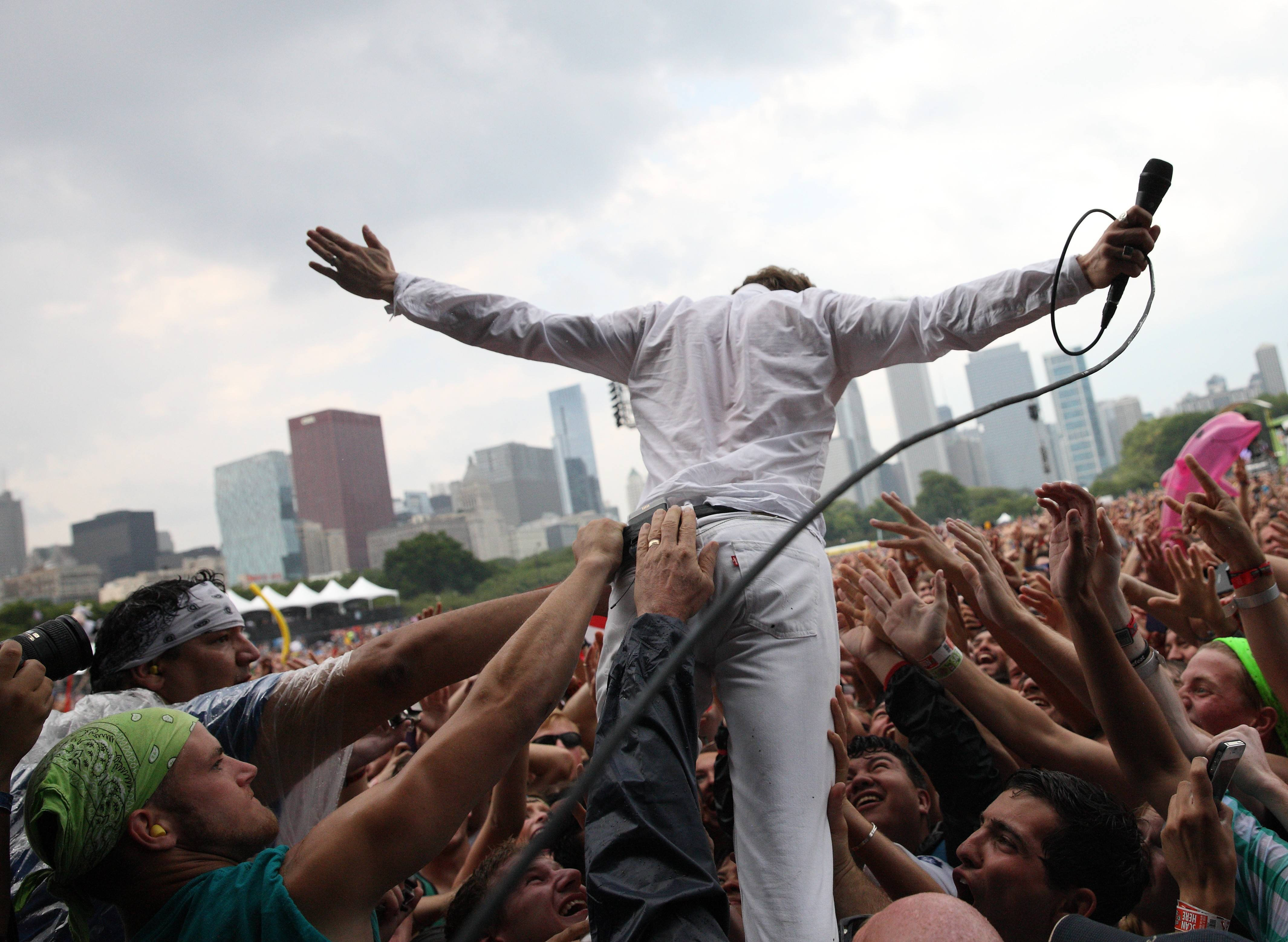 Matt Shultz of Cage The Elephant has a little fun with crowd Sunday at Lollapalooza in Chicago's Grant Park.