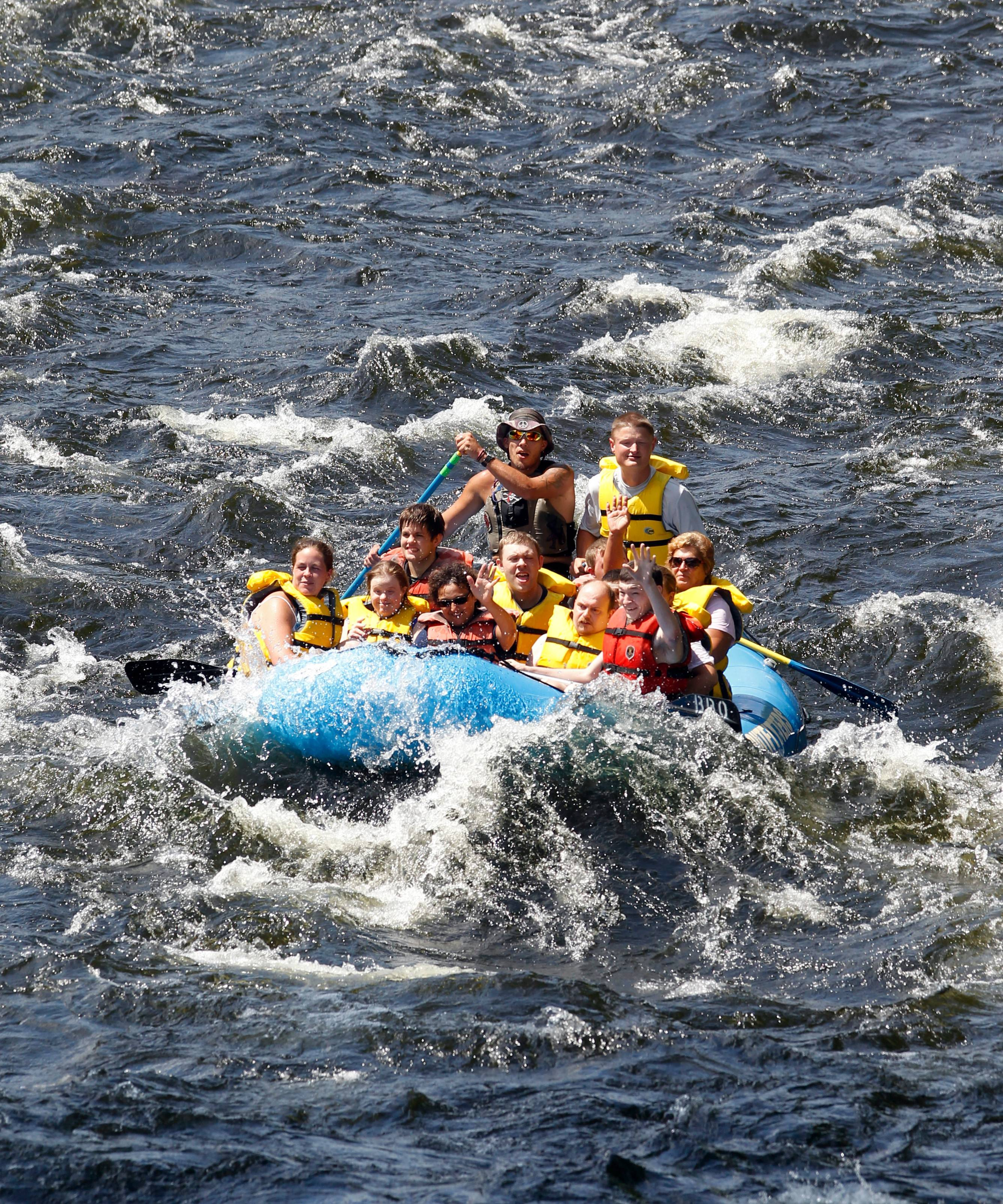 Whitewater rafters head down the Sacandaga River in Lake Luzerne, N.Y. Whitewater rafting, which is both thrilling and basically safe, often appeal to teenagers.