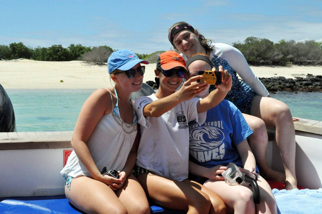 Put teens in charge of taking photos (including selfies with their friends) while traveling as a family. Let them bring a friend or two along, too, if you can afford it.
