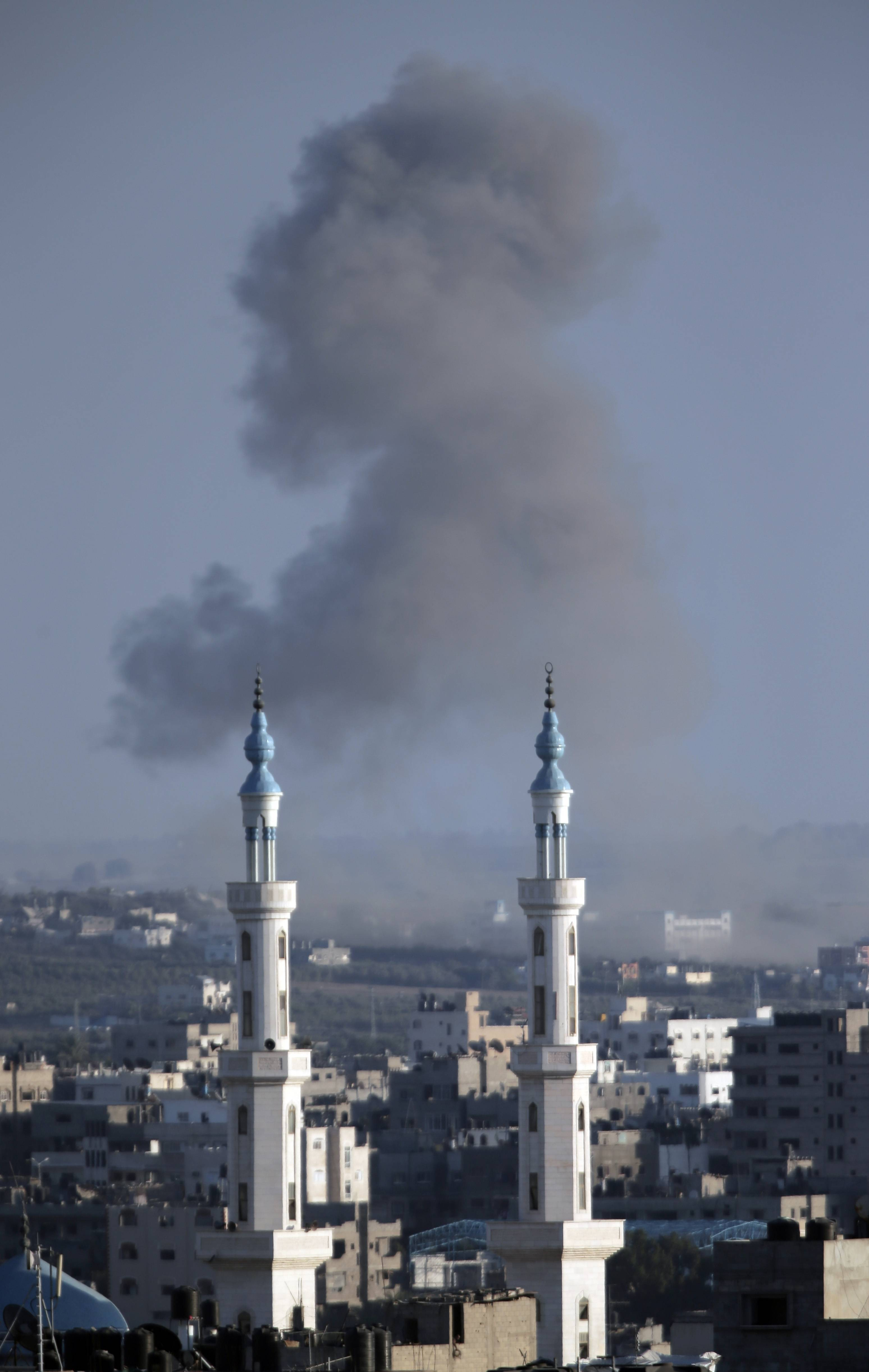 Smoke rises from an Israeli strike Sunday over Gaza City in the northern Gaza Strip.