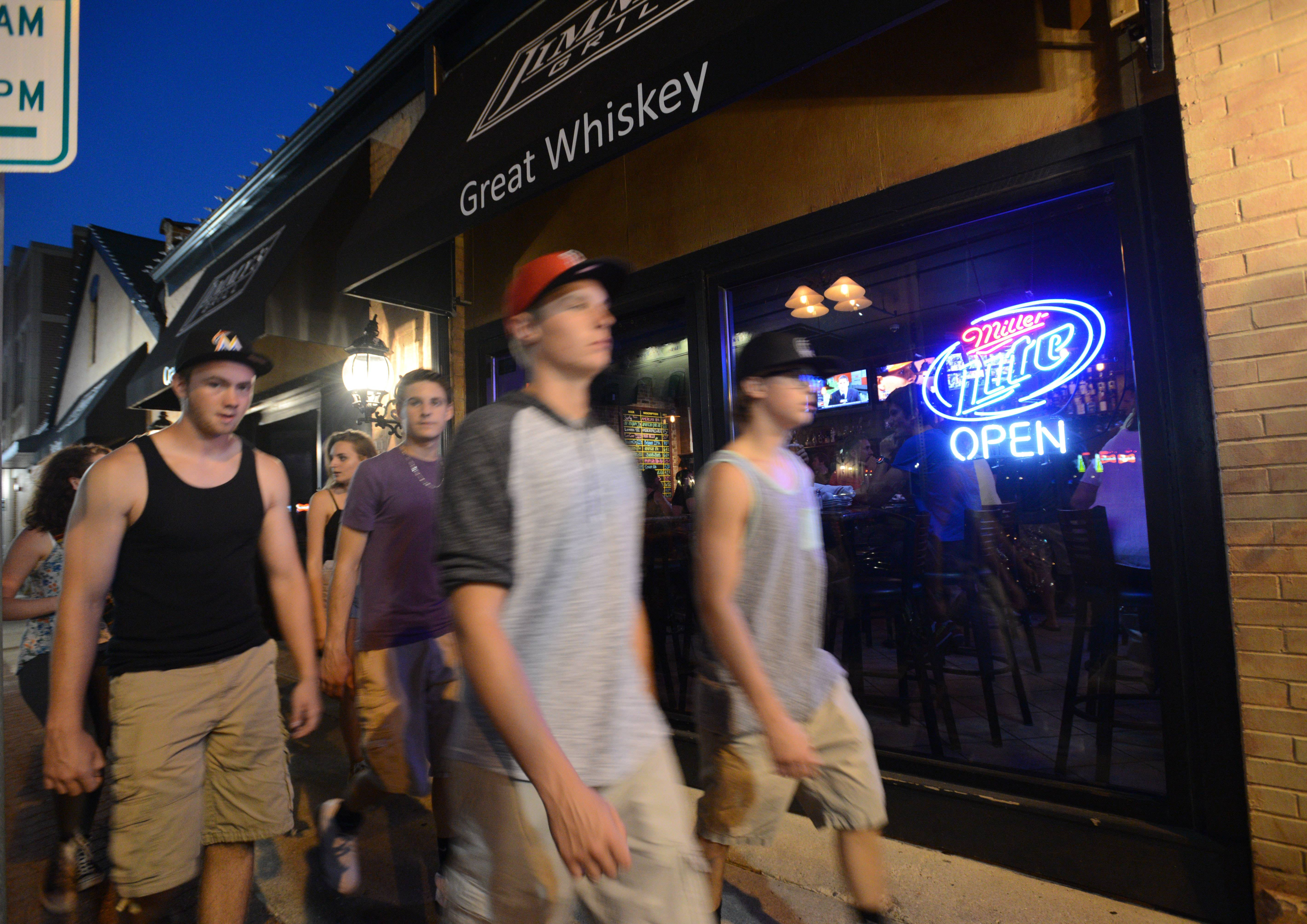 Naperville officials are considering restrictions to downtown night life that could result in shorter bar hours, no shots after midnight, cover charges after 10 p.m. or ID scanners at bar entrances.
