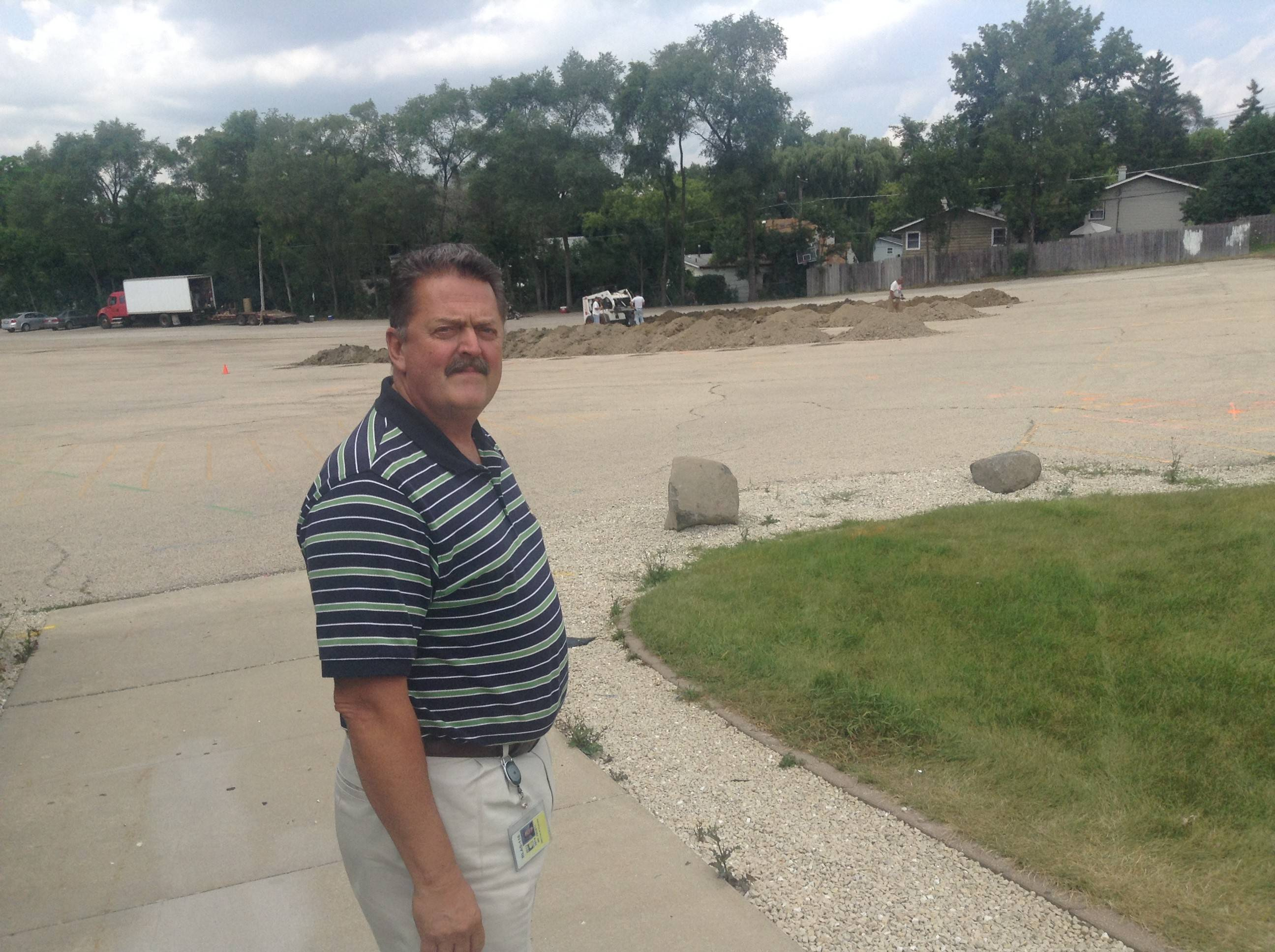 Round Lake Area Unit District 116's director of buildings and grounds, Charles Privett, shows where six new mobile classrooms and two restrooms will be in trailers at Round Lake High School for the 2014-15 academic year.