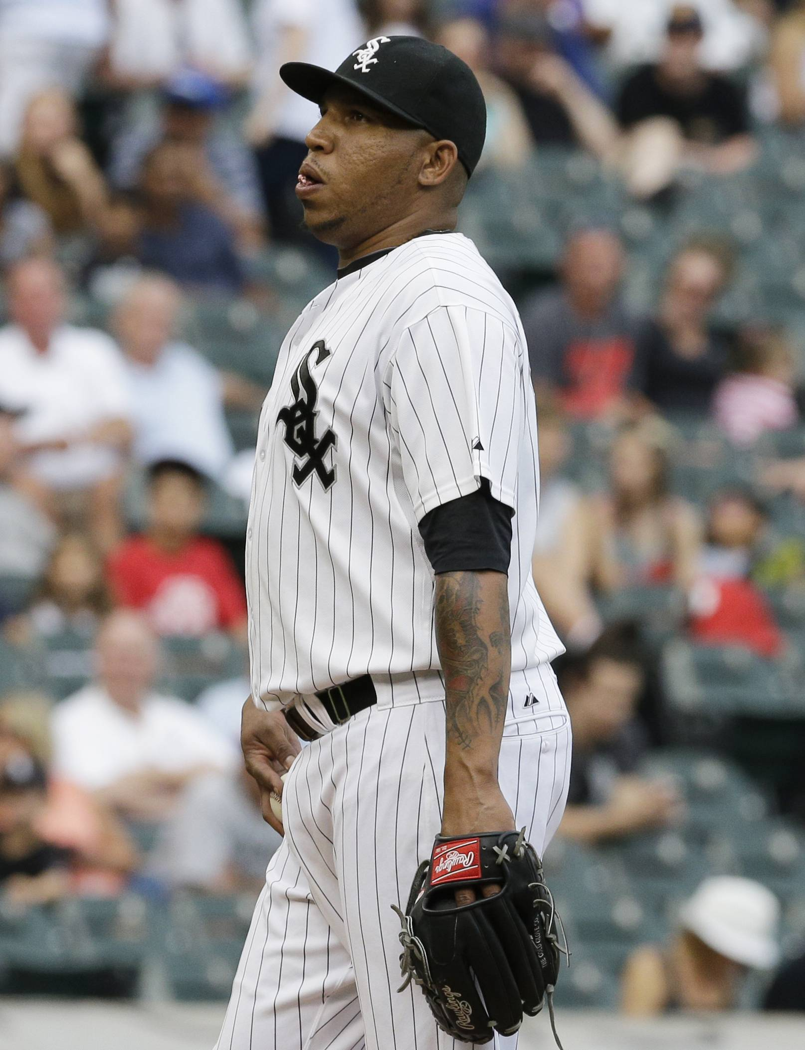 Chicago White Sox relief pitcher Ronald Belisario reacts during the eighth inning of a baseball game against the Minnesota Twins in Chicago, Sunday, Aug. 3, 2014.