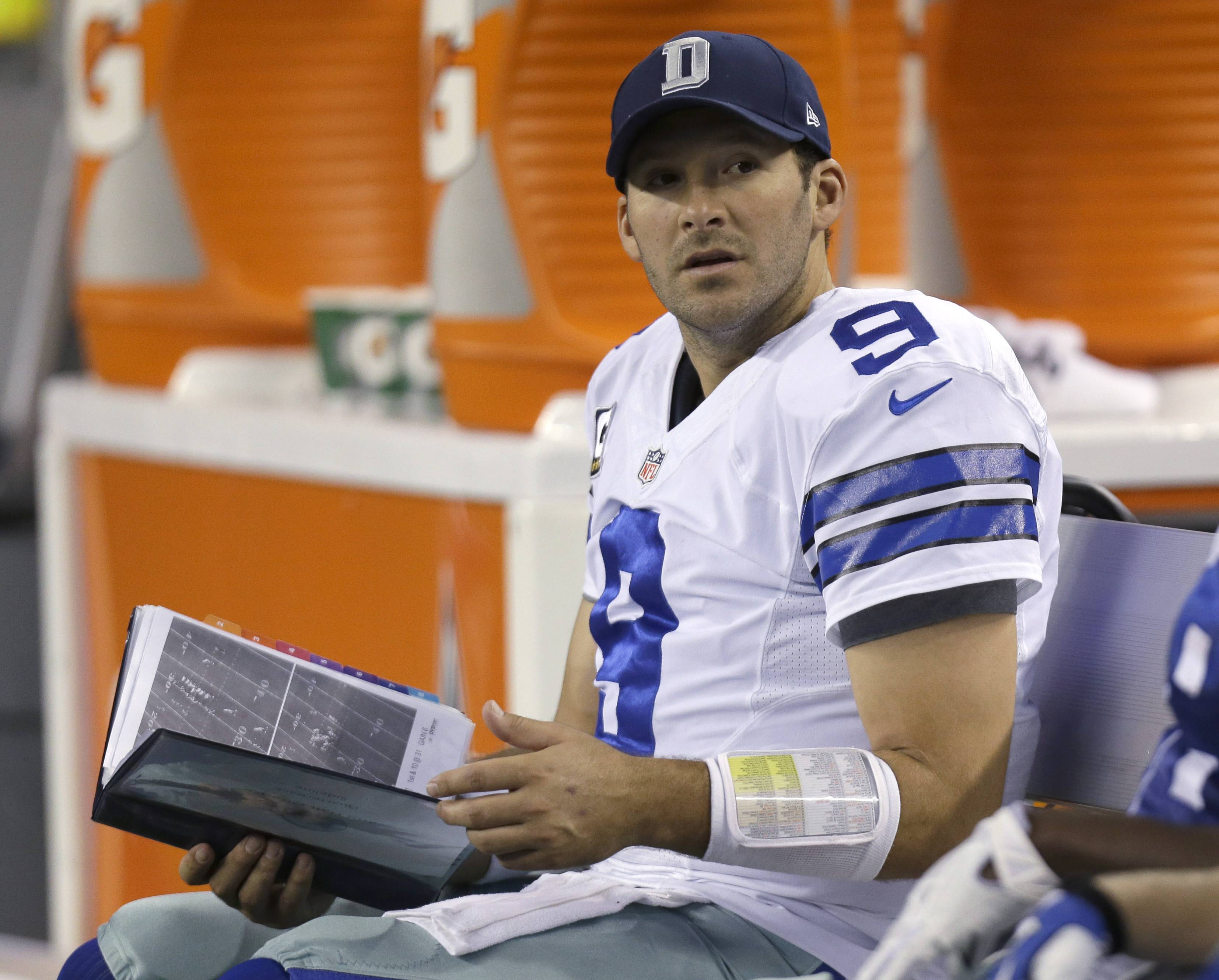 In this Dec. 15, 2013, file photo, Dallas Cowboys quarterback Tony Romo sits on the bench with a book of play printouts during the second half of an NFL football game against the Green Bay Packers in Arlington, Texas. NFL teams used to take Polaroid pictures of plays from atop the stadium during games then send them down to the field on a rope. Technology improved so that an automated camera could deliver the images to a printer on the sideline, creating that familiar sight of a quarterback staring at a sheet of paper to figure out what went wrong on an interception. That was still the case last season, when fans in the stands could watch highlights on their smartphones, but players and coaches were flipping through three-ring binders of black-and-white photos.