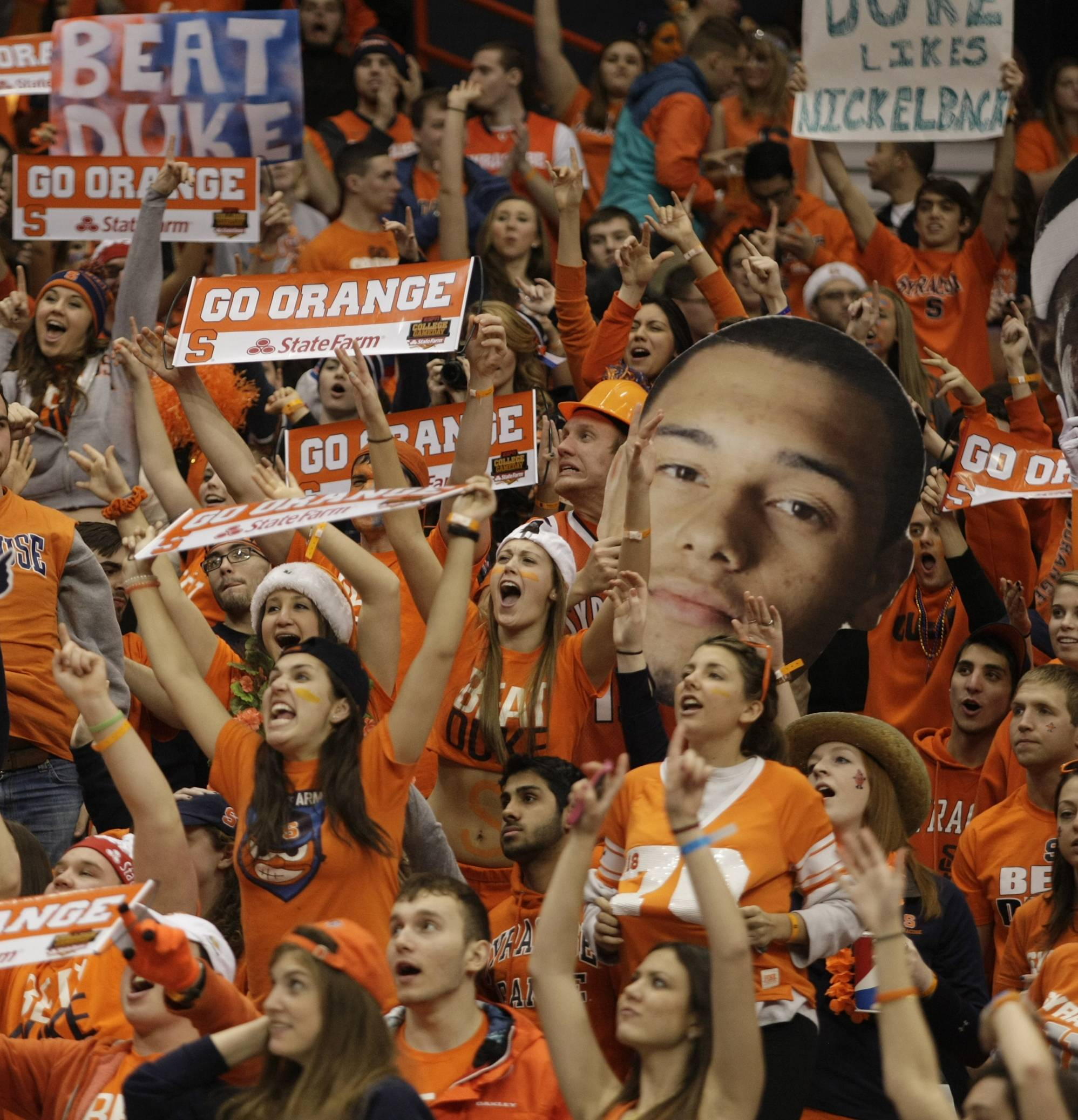 Basketball fans celebrate after Syracuse defeated Duke on Feb. 1 at home. The Princeton Review's annual rankings, released Monday, put the New York university at No. 1 on the list of the nation's top party schools.