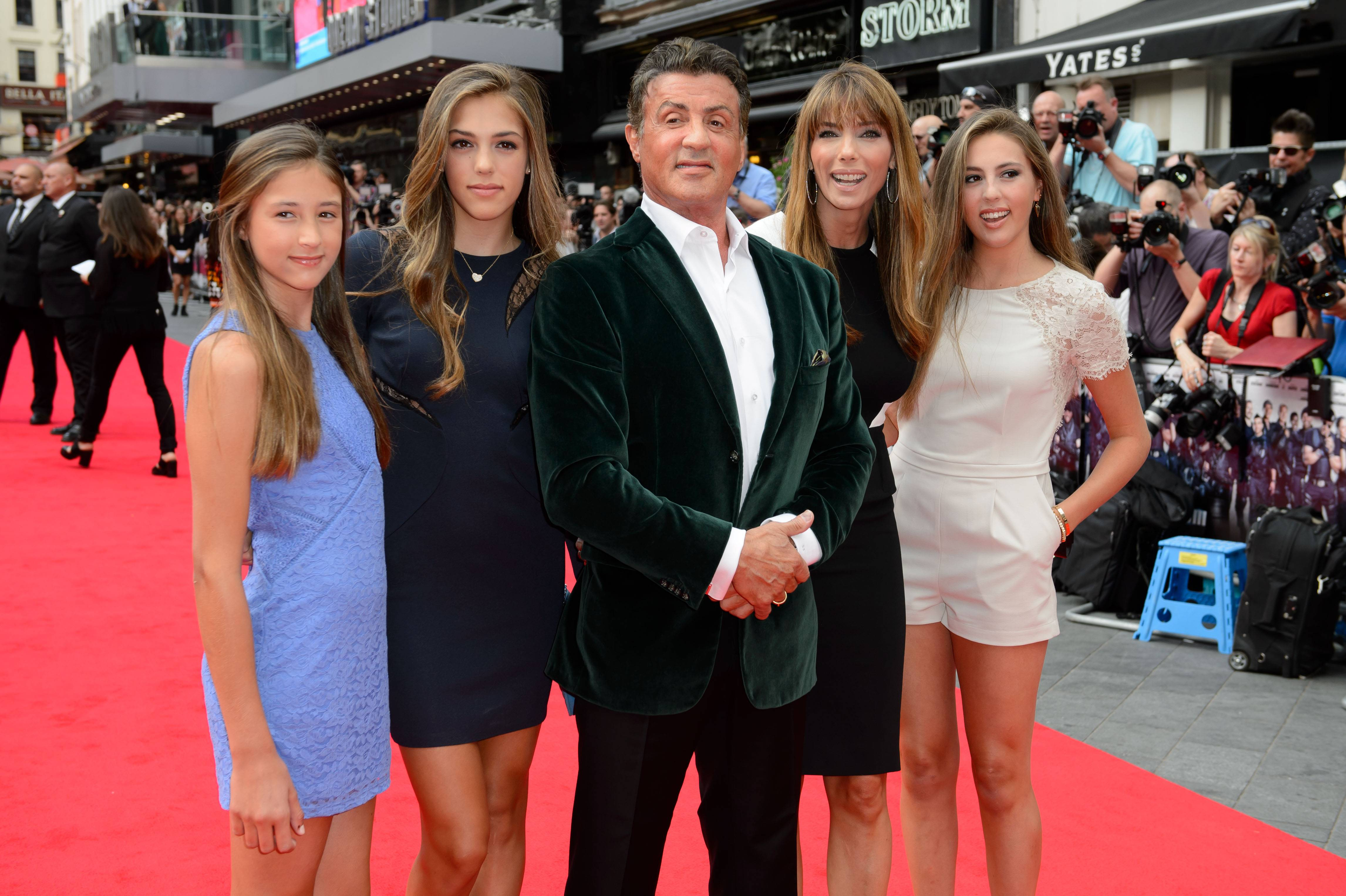 "Sylvester Stallone, center, with his wife, Jennifer Flavin, second right, and daughters, Sophia Stallone, Sistene Stallone and Scarlet Stallone, arrive for the world premiere of ""The Expendables 3"" in London Monday."