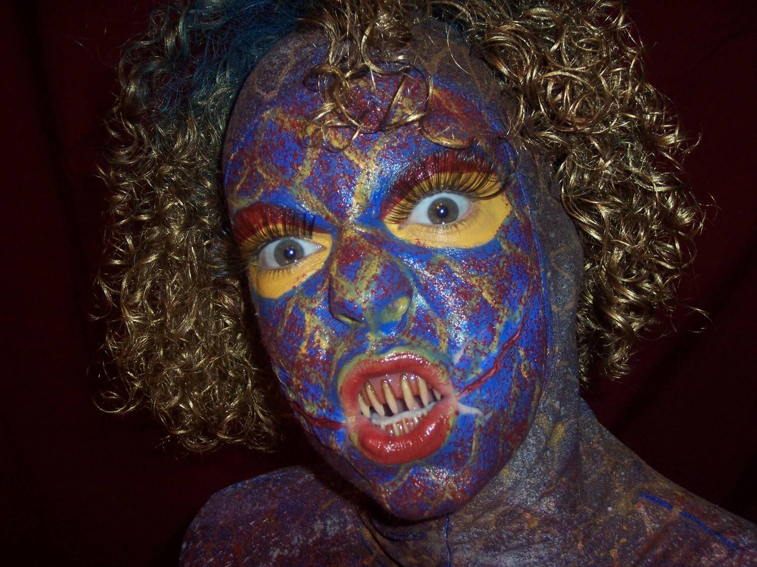 Colleen Miller, a Naperville native, models her horror effects makeup.