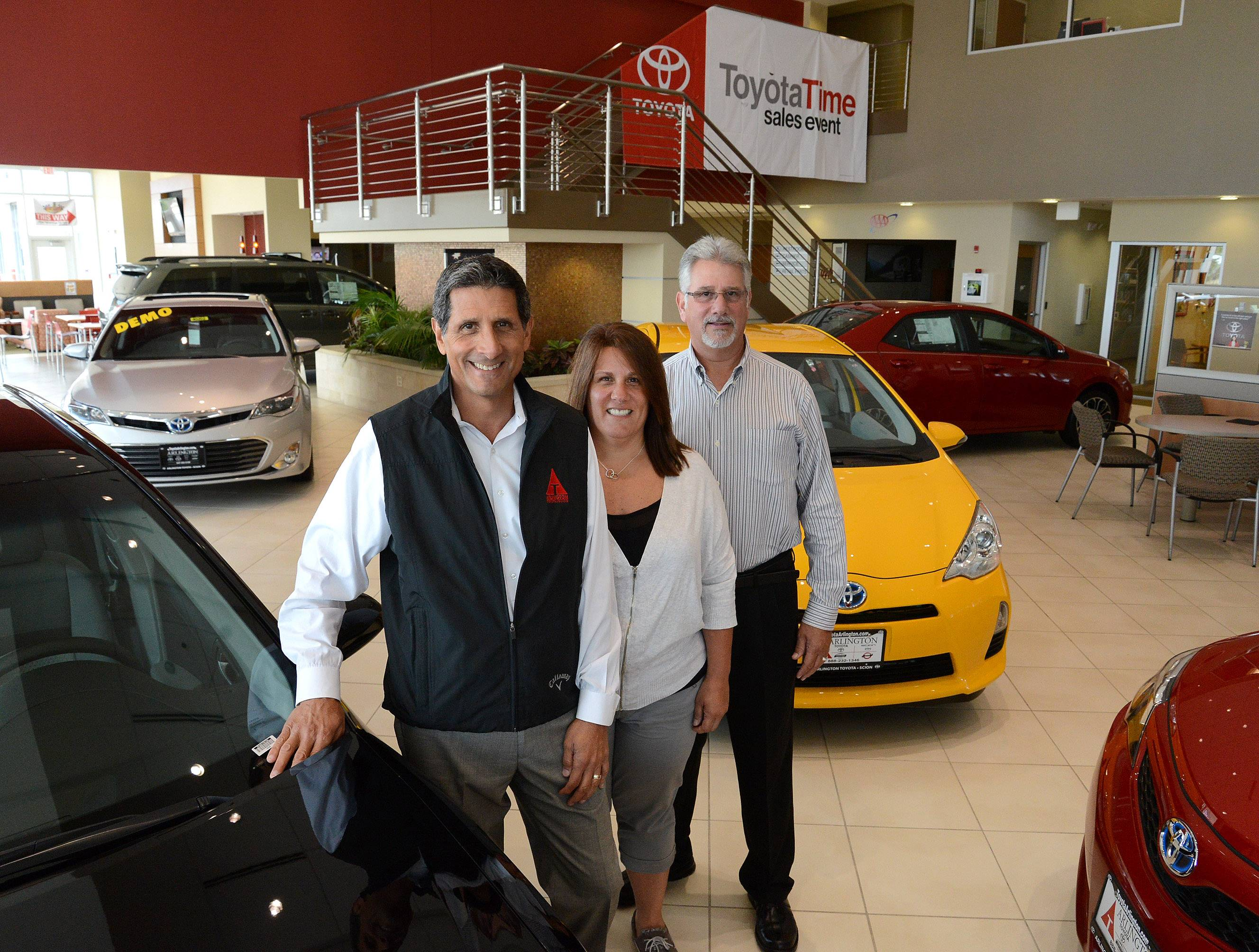 Arlington Automotive Group President Gary Vicari, left, is joined in the family business by siblings Tracey Vicari, human resources manager, and Scott Vicari, vice president, in the showroom of their Arlington Toyota/Scion in Palatine.