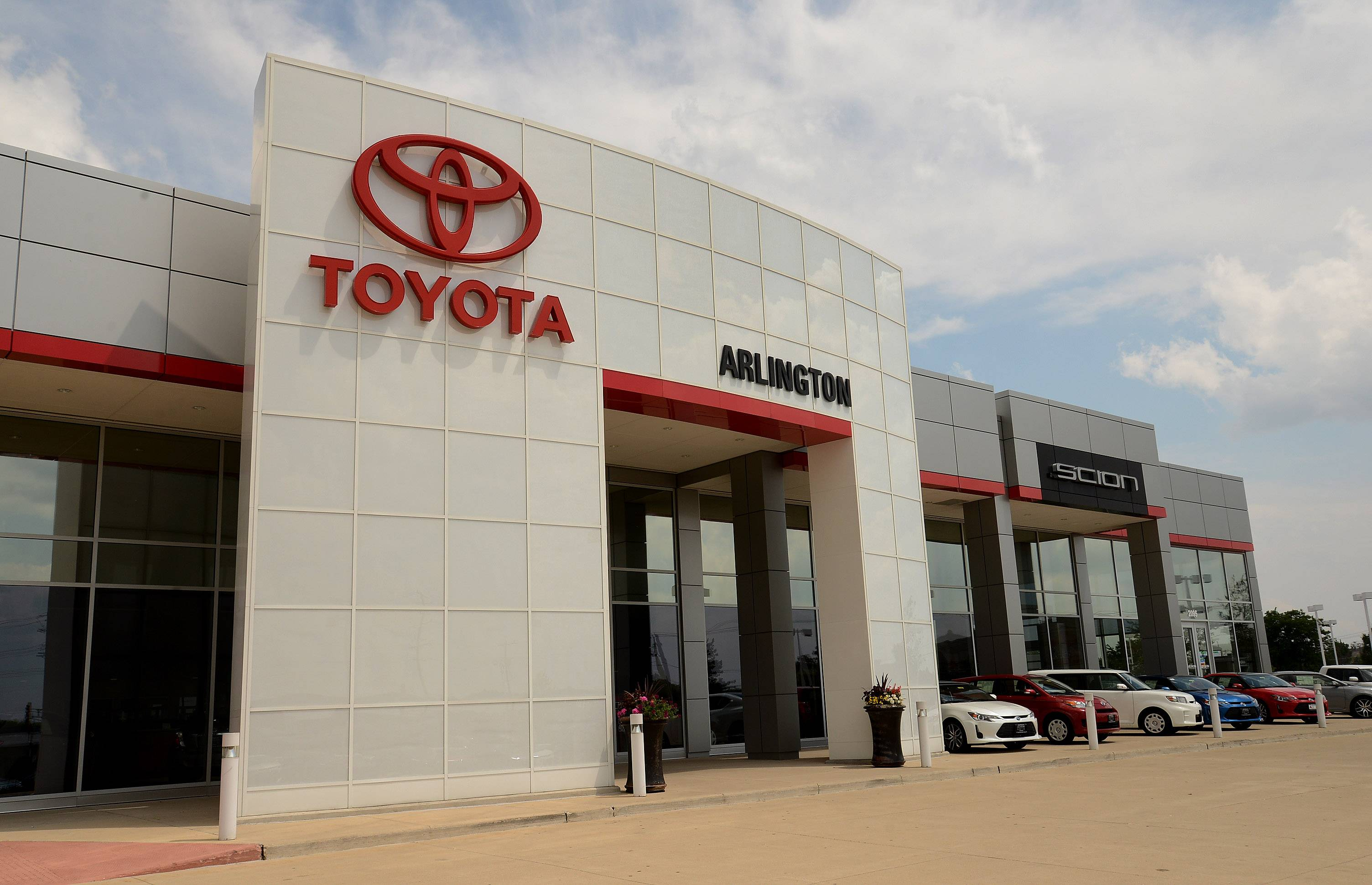 Arlington Toyota/Scion operates a 56-bay service, parts and collision center. Fewer than one-third of new car dealerships offer body shop services. At left, the dealership moved to its 15-acre campus five years ago.