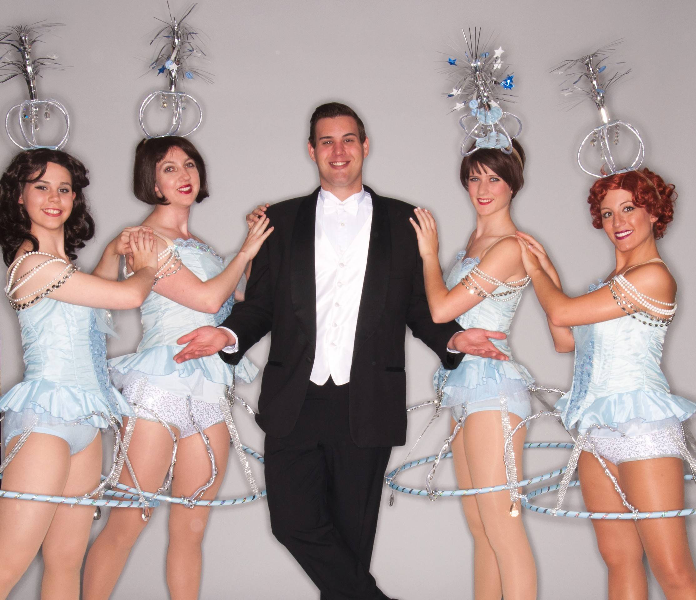 "Brett Baleskie, center, poses with the Follies Girls, including Kaitlyn Ball, Kara Sandquist, Aly Stanczek and Lindsey Prerost in the Fremont Theater Company production of ""Crazy for You."""