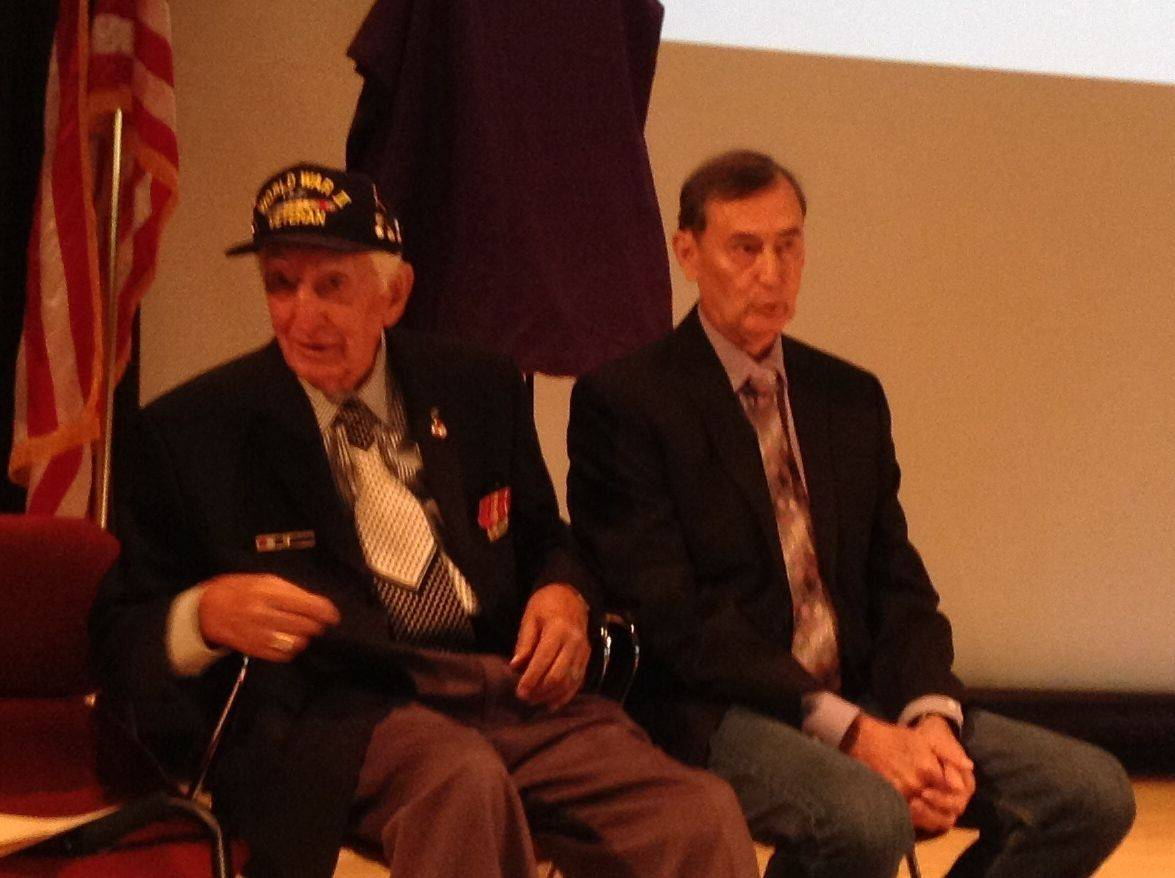 Former Army Staff Sgt. John Trinca of Antioch Township, left, and Thomas Bateman Jr. at Sunday's Purple Hearts Reunited Medal Presentation at the College of Lake County. Bateman received his father's World War II Purple Heart medal, which had been missing for more than 60 years.